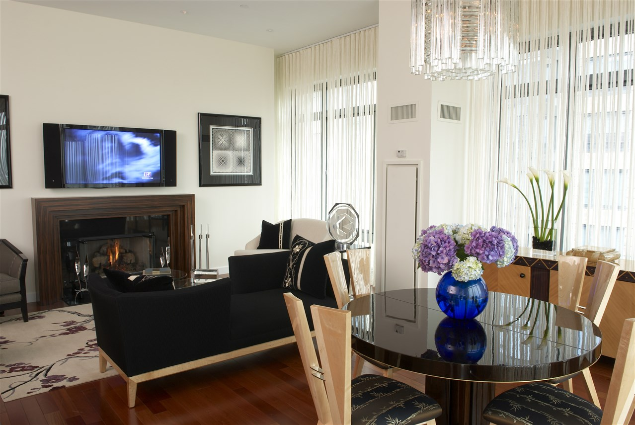Living room with glass round table for four