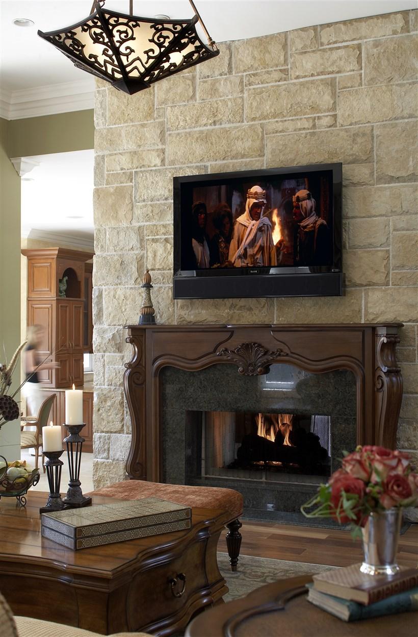Burning fireplace below the movie screen