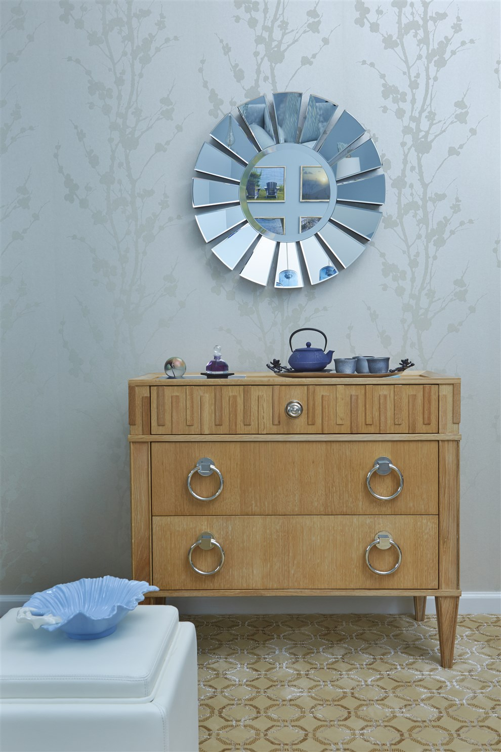 Wooden cabinet and stylish mirror on the wall
