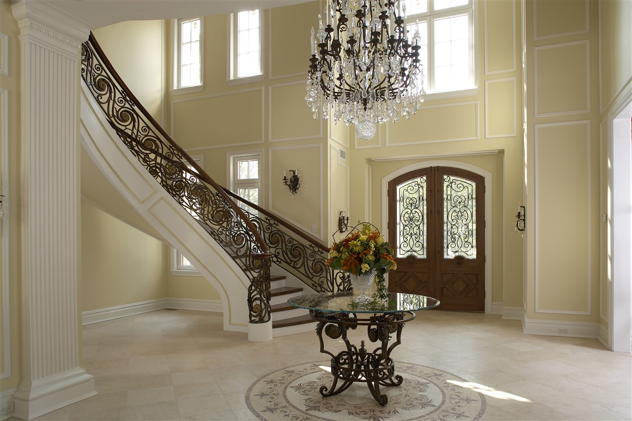 Staircase with artistic design railing