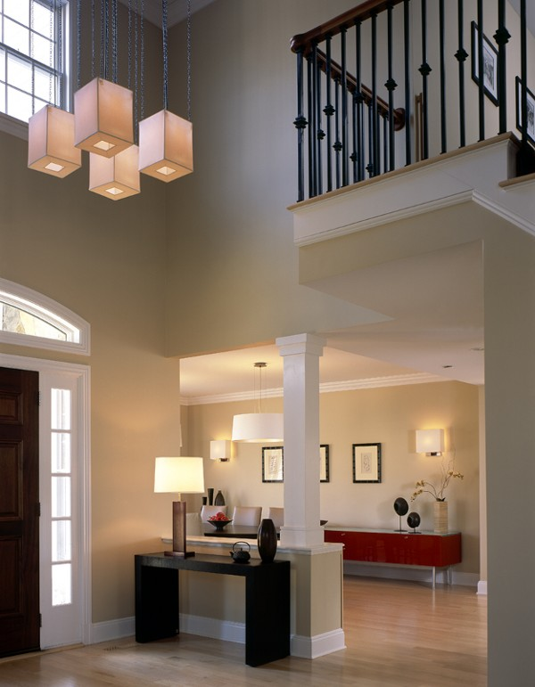 Modern house entrance with wooden table and lamp