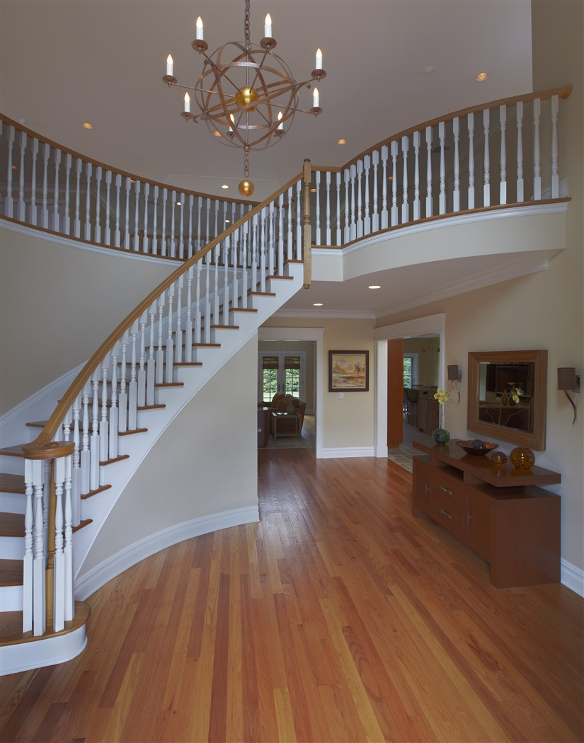 Curve staircase with wooden white railing