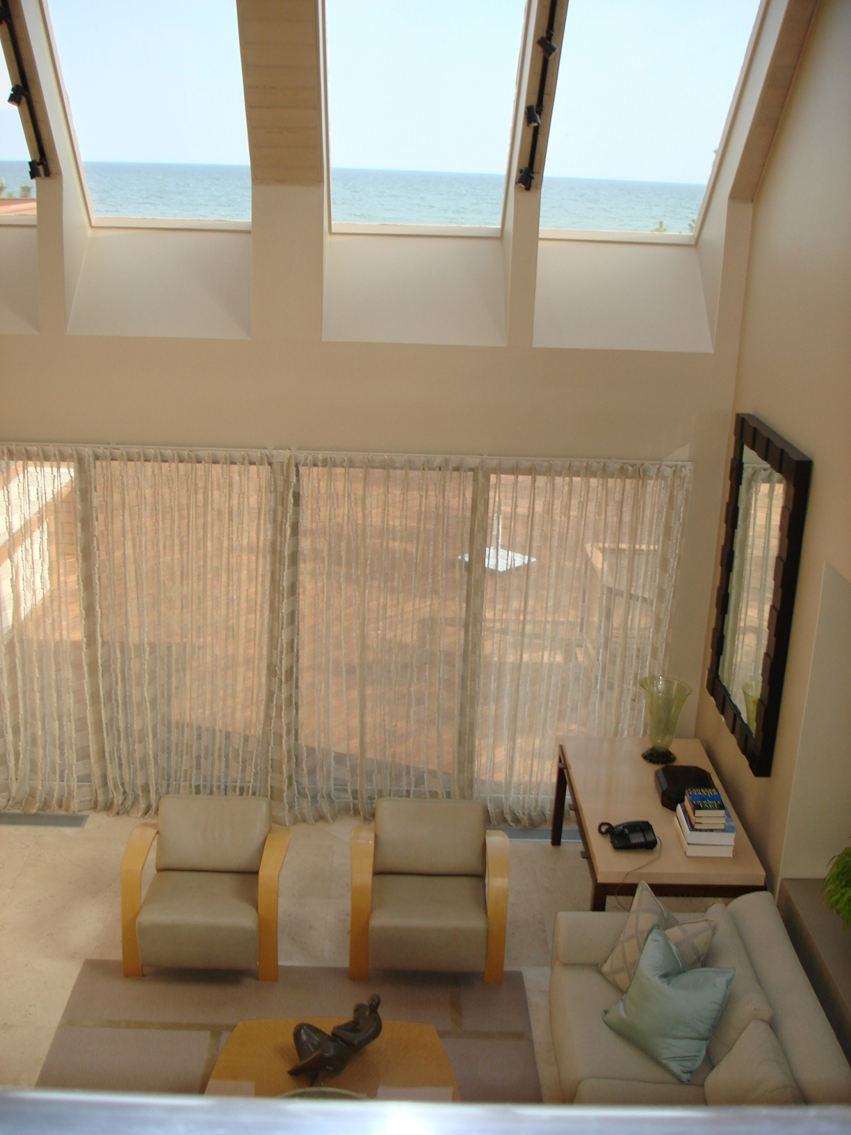 Above view of the living room, windows overlooking the sea