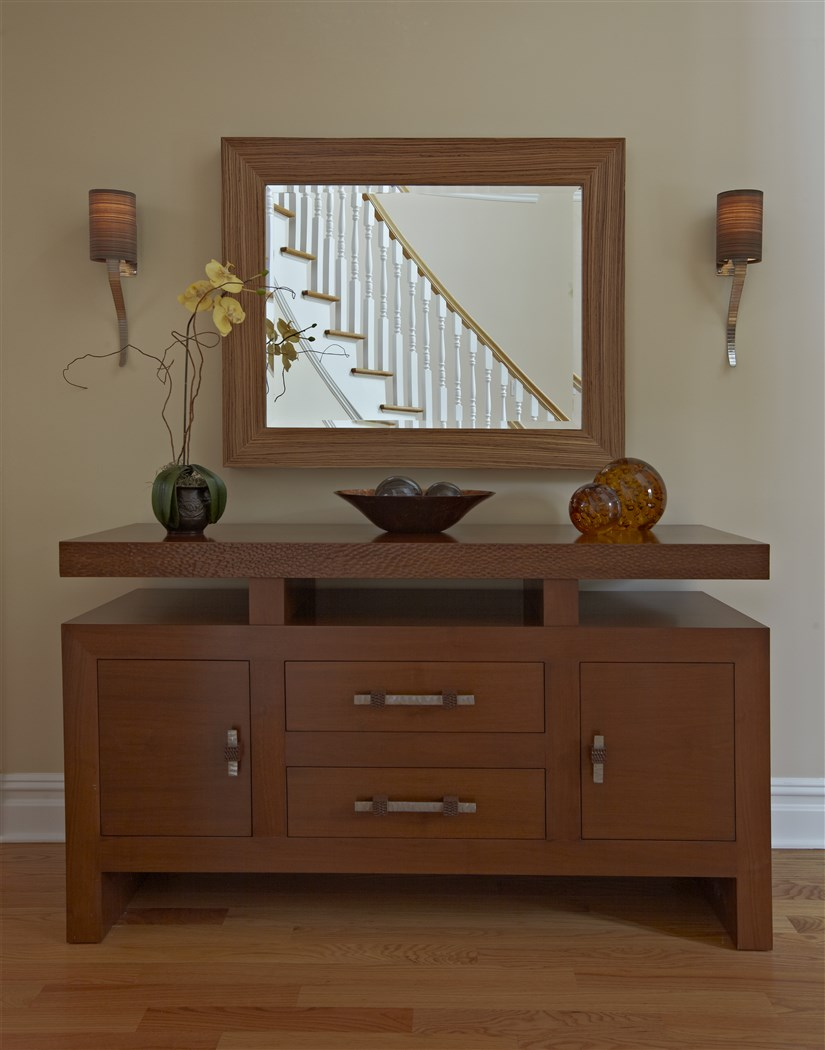 Wooden cabinet with mirror viewing stairs
