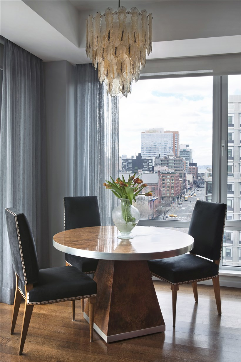 Round Table for three and Chandelier