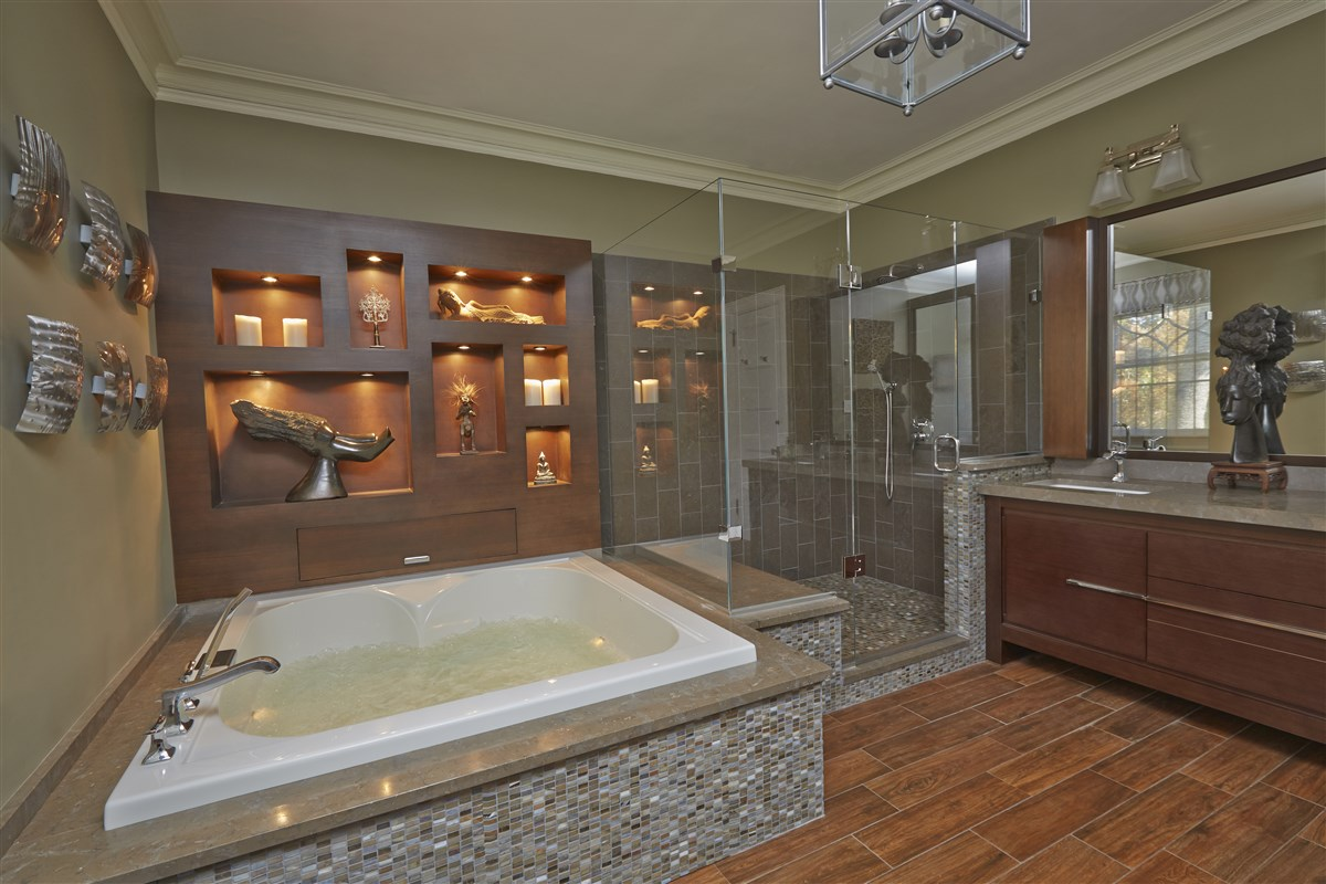 Modern bathroom with bathtub and wooden shelves