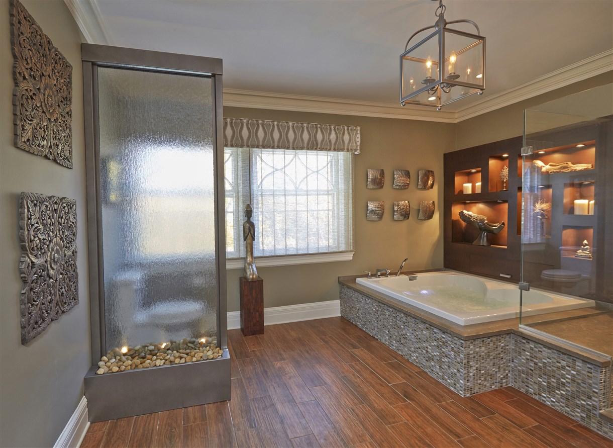 Modern bathroom interior with stone wall design bathtub
