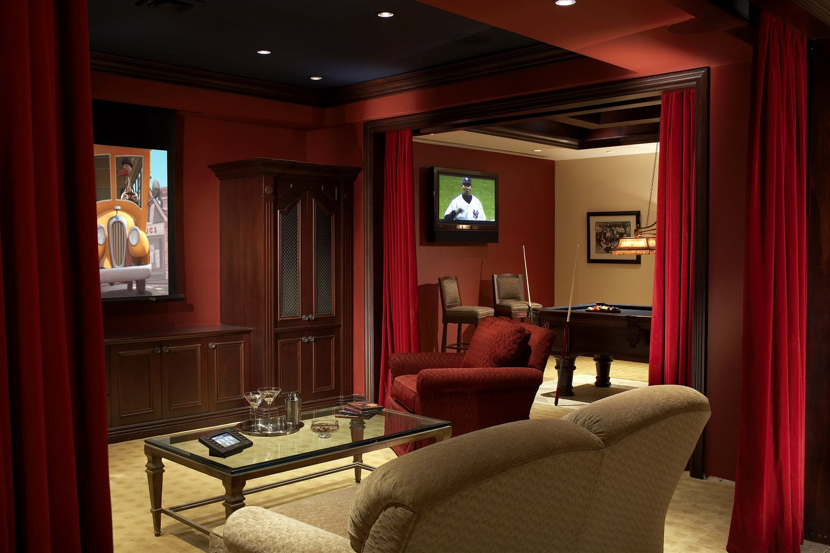 Entertainment room with movie screen and pool table