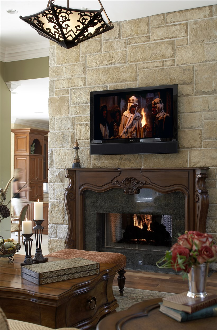 Burning fireplace below the movie screen
