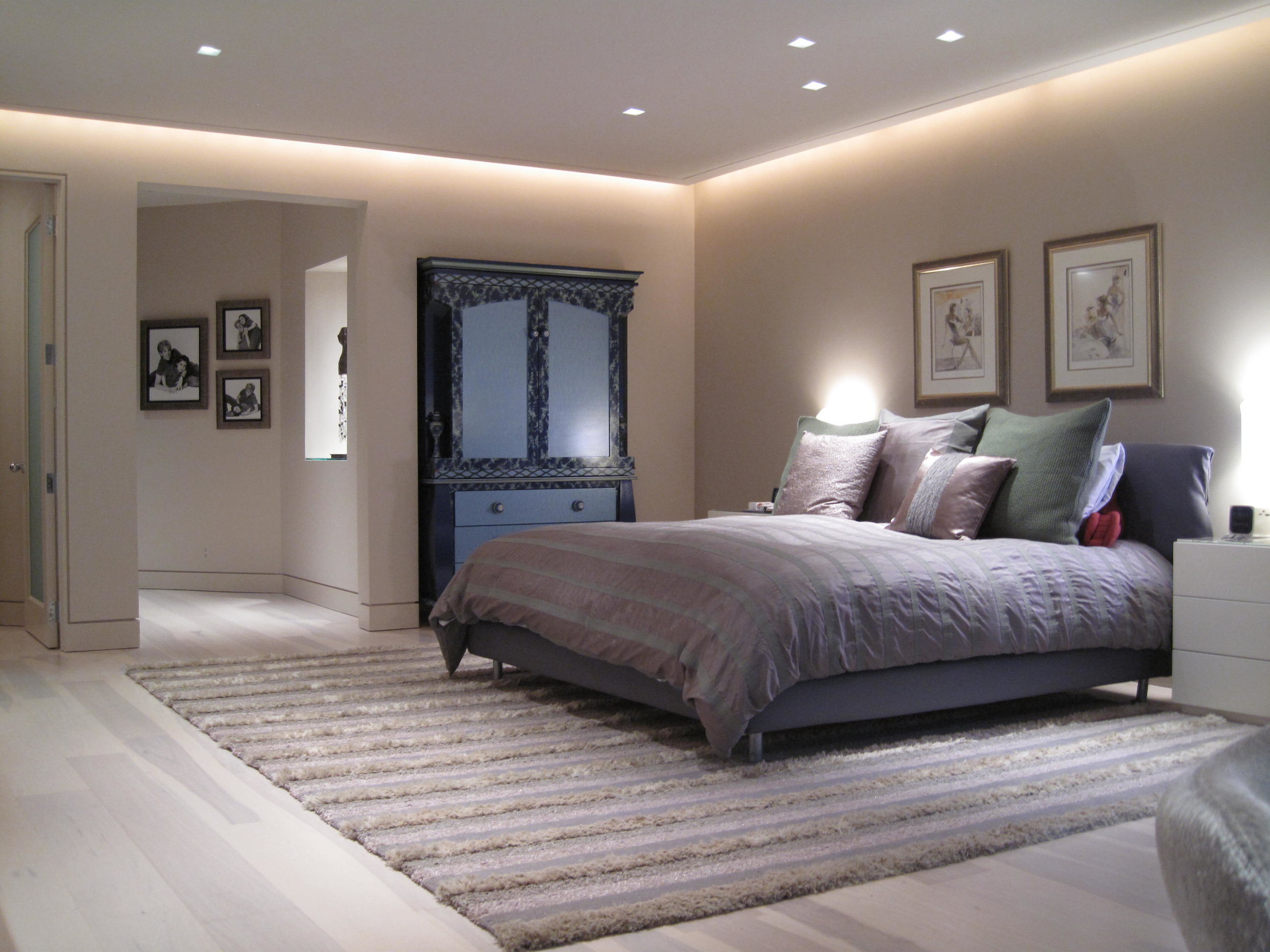 Spacious bedroom design with framed painting on the wall