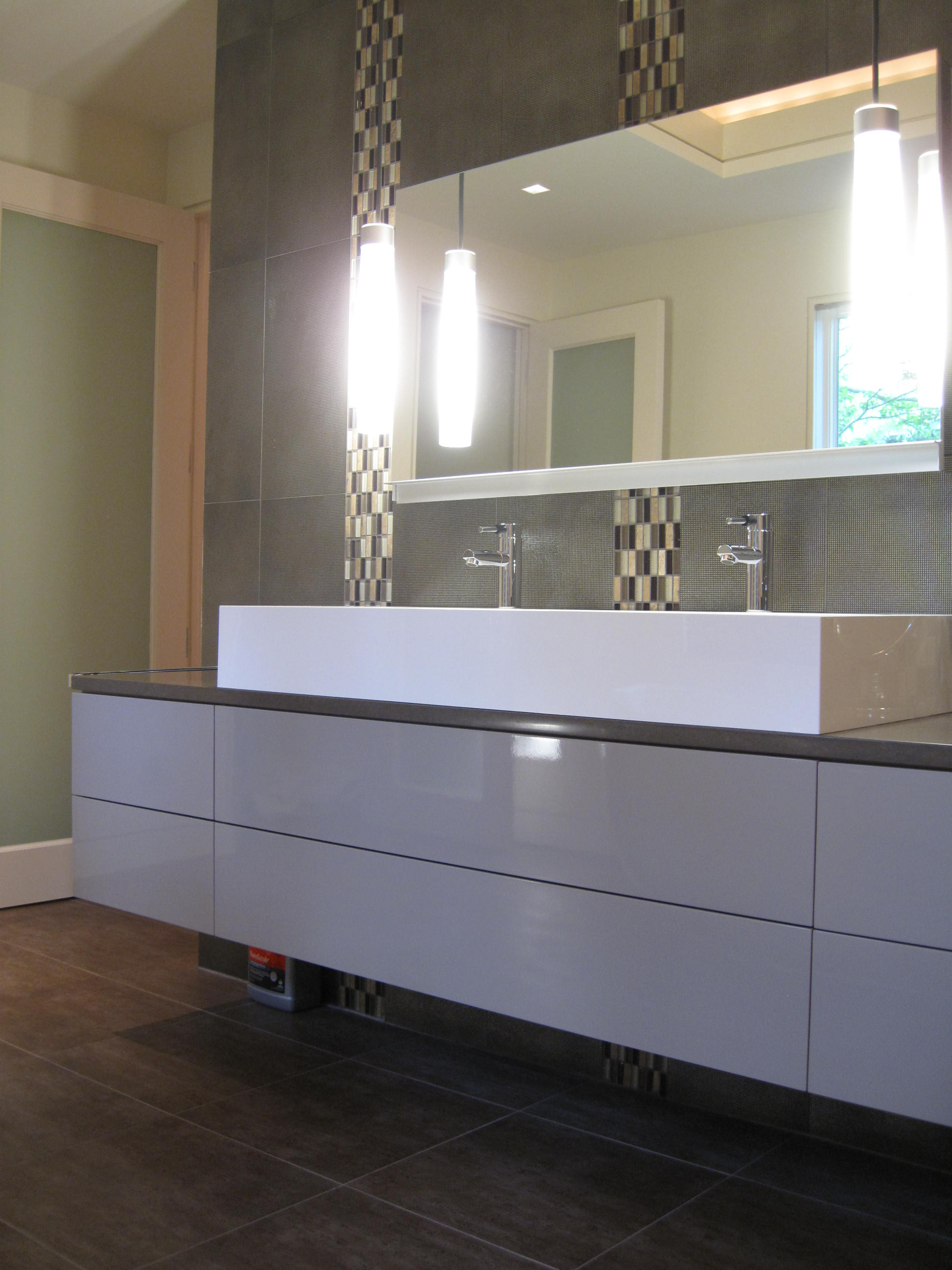 Sink and faucet area with mirror