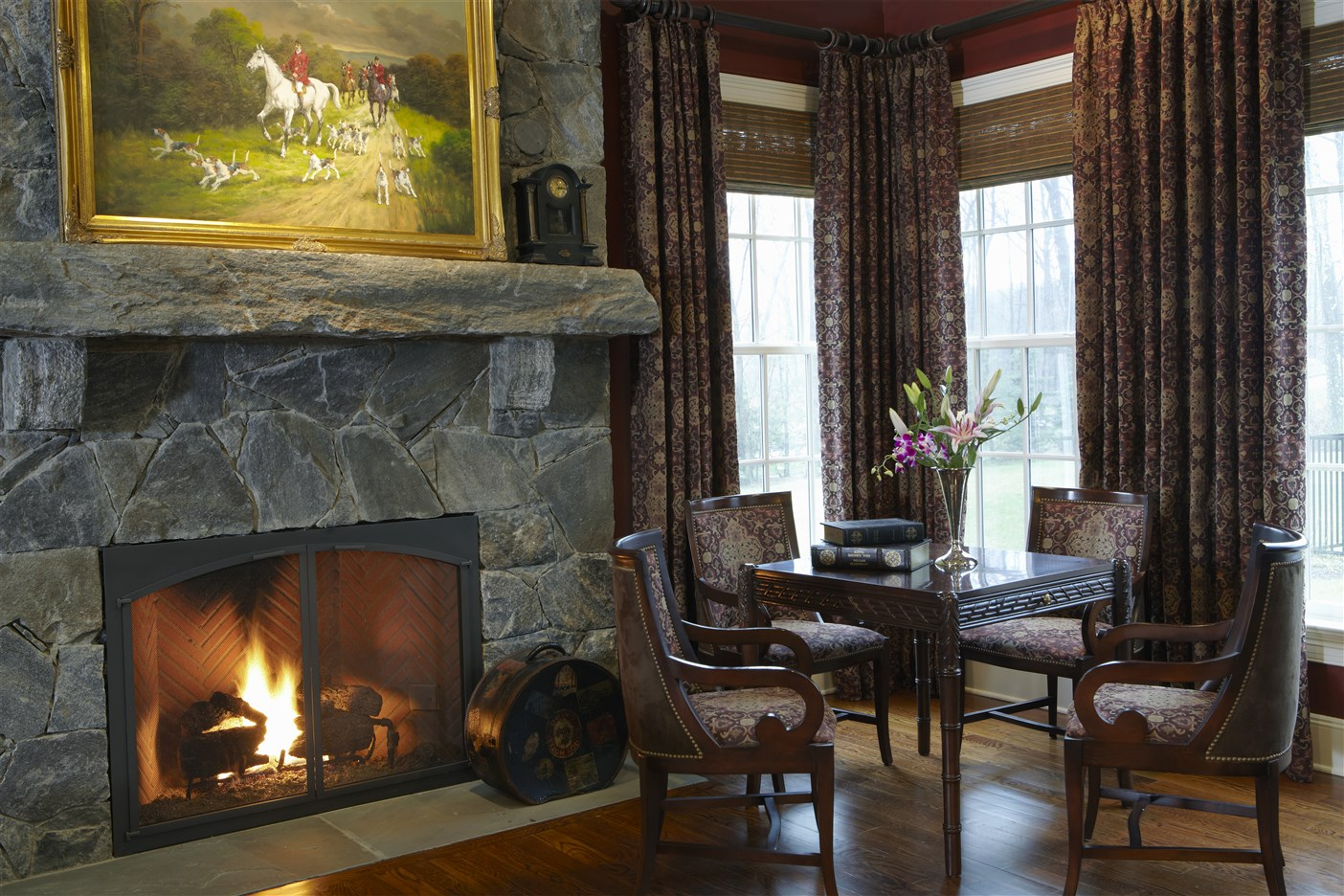 living room with table for four and fireplace
