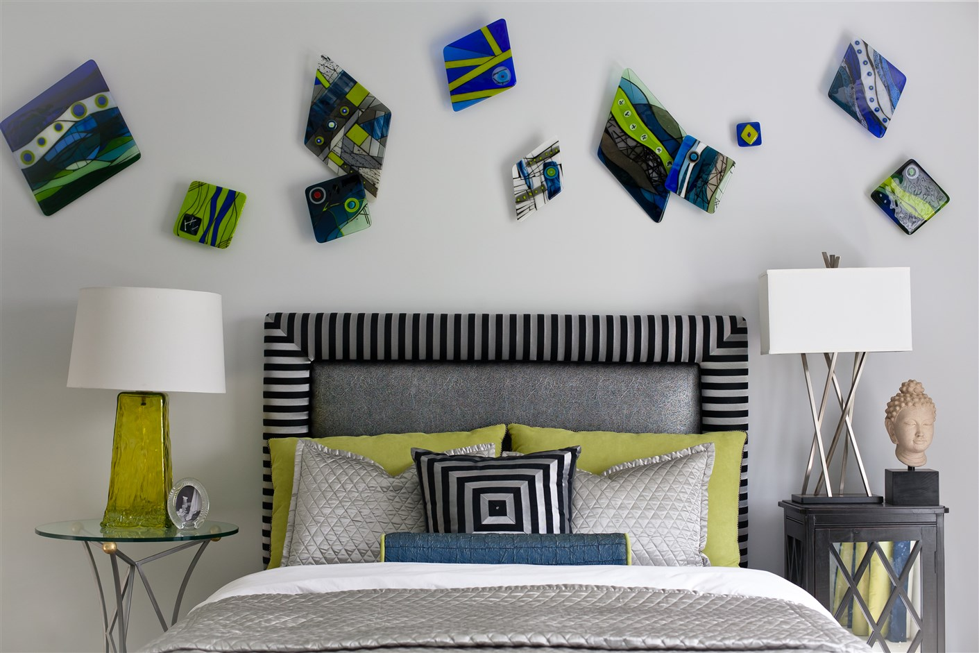 Bed with black and white stripes headboard