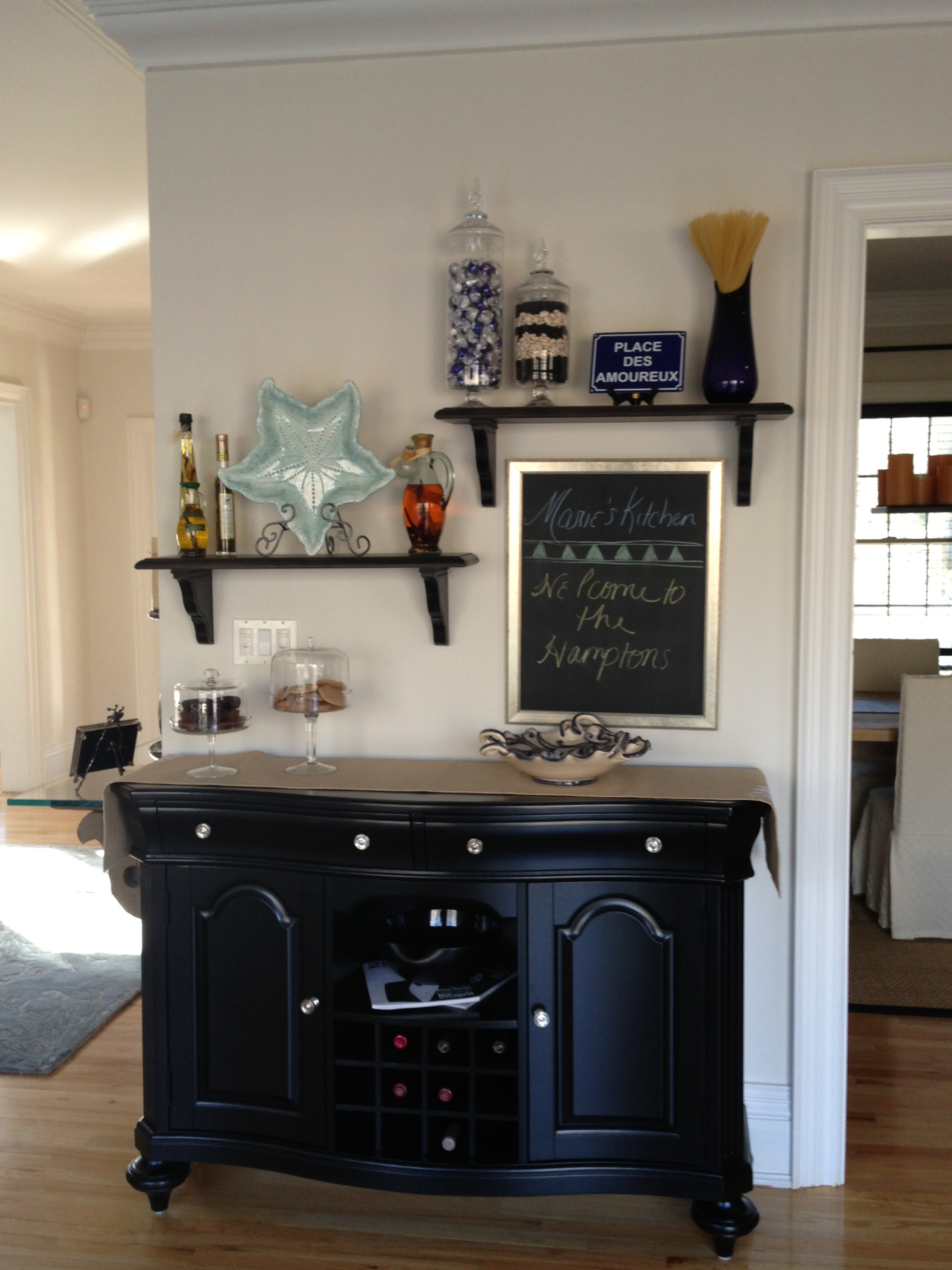 Black wooden cabinet and decorations on the wall