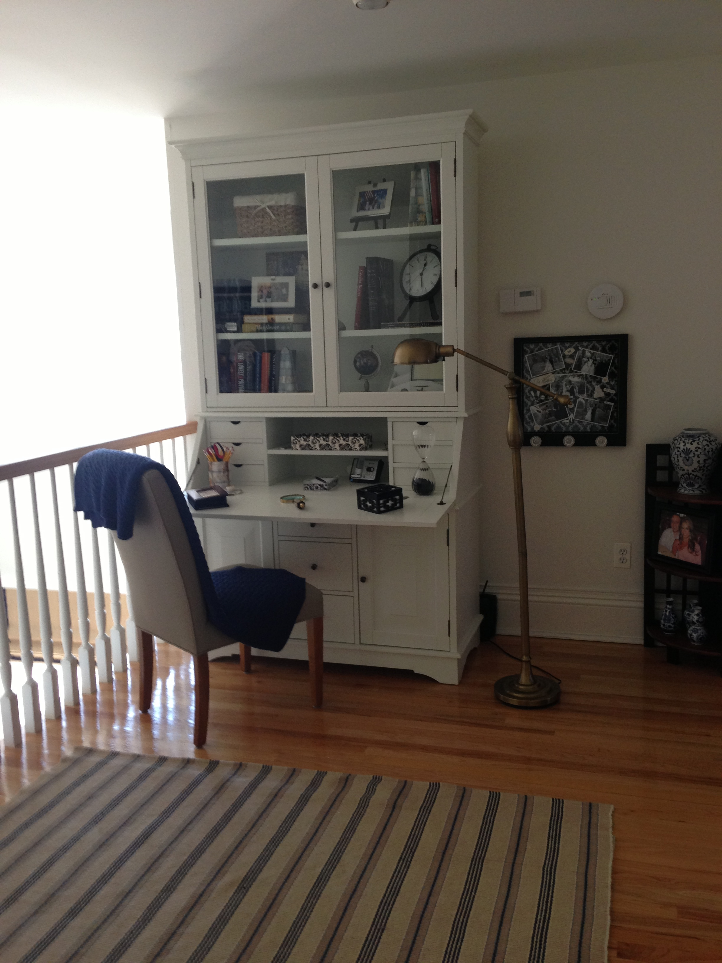 White cabinet on the wall and a blue chair