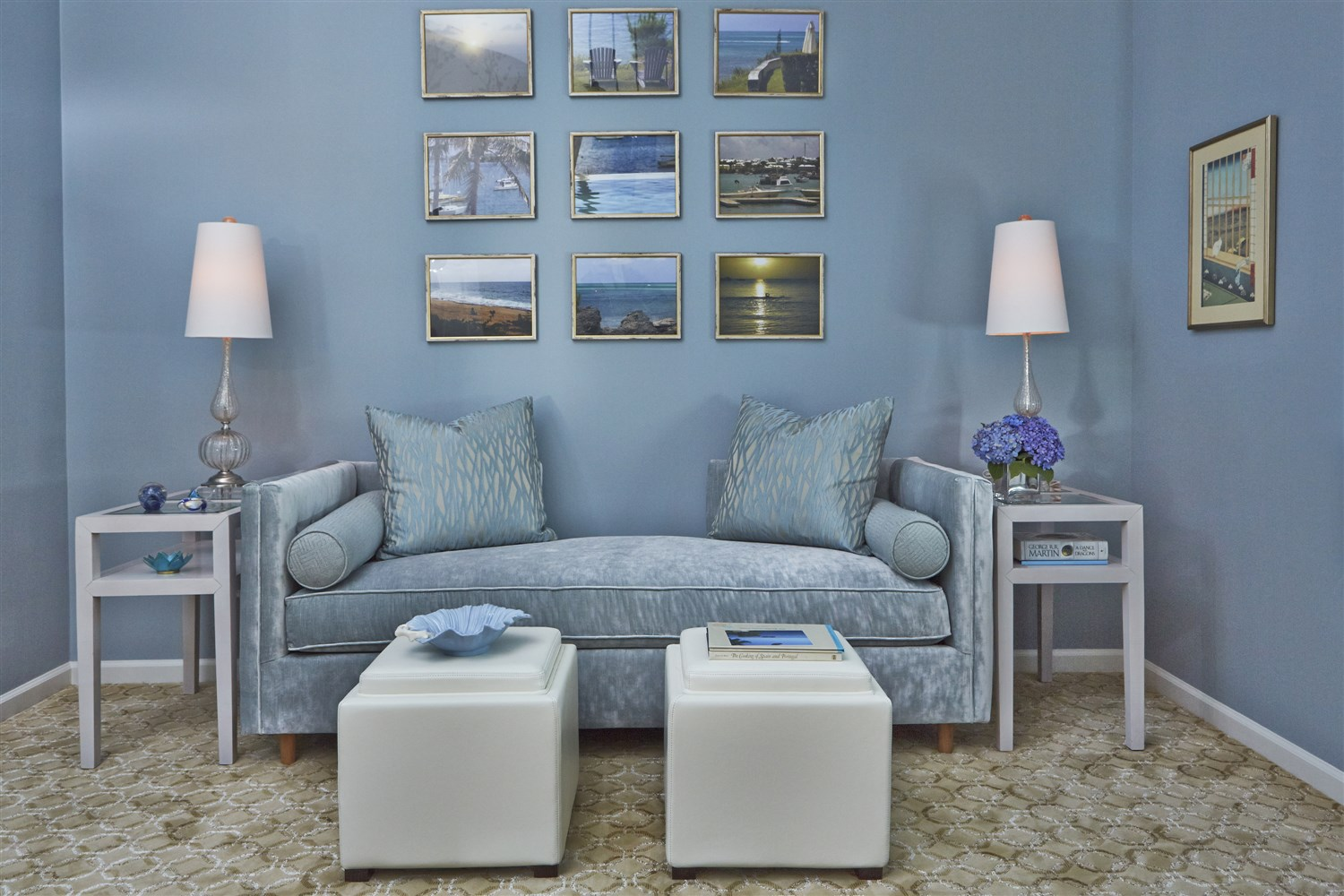 Living room with framed paintings on the wall and sofa set