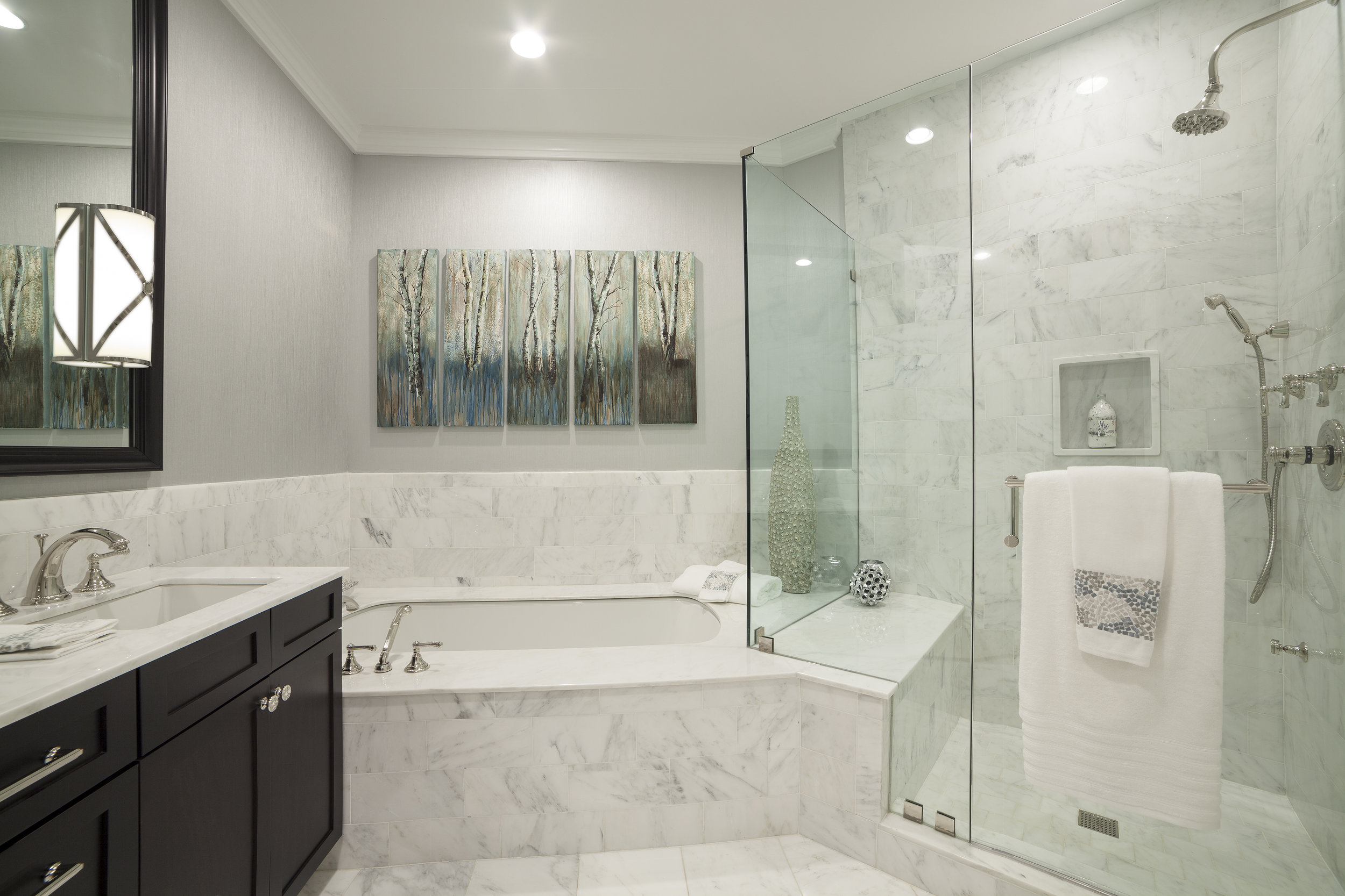 modern style bathroom with bathtub, shower and sink