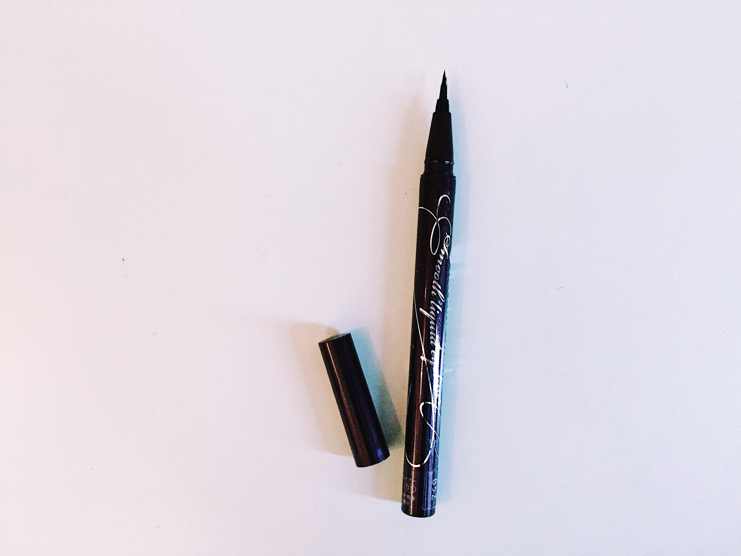 KissMe Heroine - A Japanese eyeliner that is super popular amongst the Asian beautify community Pros: Tiny tip allows for the highest precision for drawing the thinnest lines. Super waterproof—can withstand the pool and tears alike. Very dark. Cons: The brush tip can splay easily if you're not careful with the cap. Difficult to get in store in the US. The packaging is not the most aesthetic.