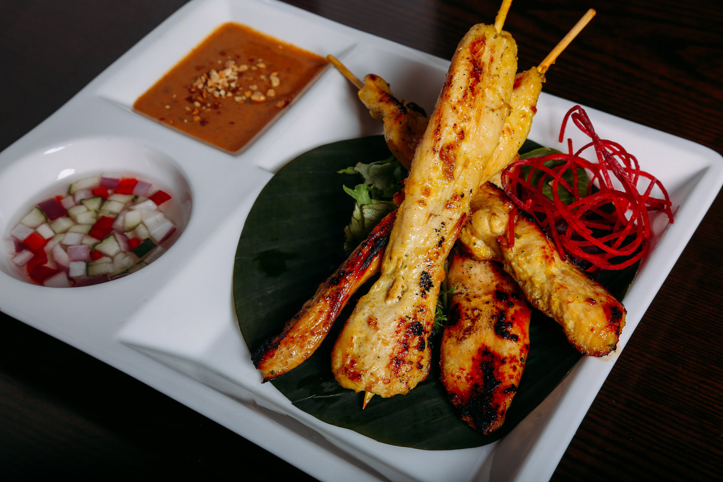 Chicken Sate      - Marinated barbecue chicken grilled on skewer with peanut sauce and cucumber relish.
