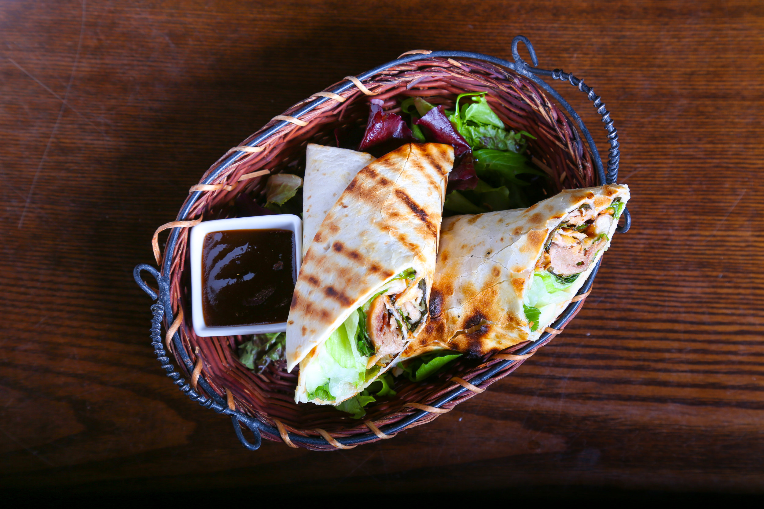 Duck Wrap     - Roasted duck, carrot, cucumber, and scallion wrapped in tortilla skin with Peking sauce.