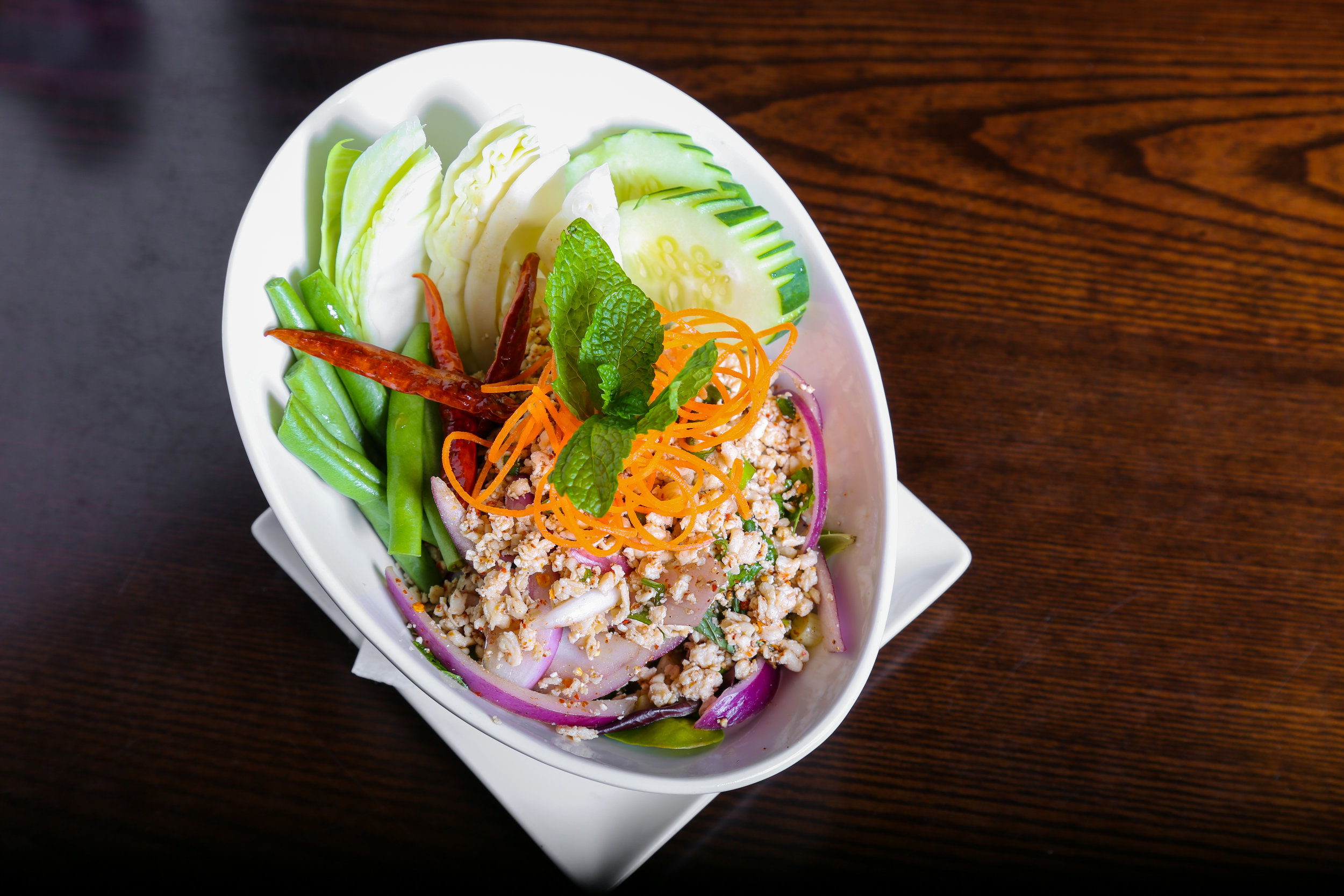 Larb(Chicken or Pork )    - Minced chicken or Pork, shallot, scallion, cilantro, mint and roasted rice with spicy lime dressing.