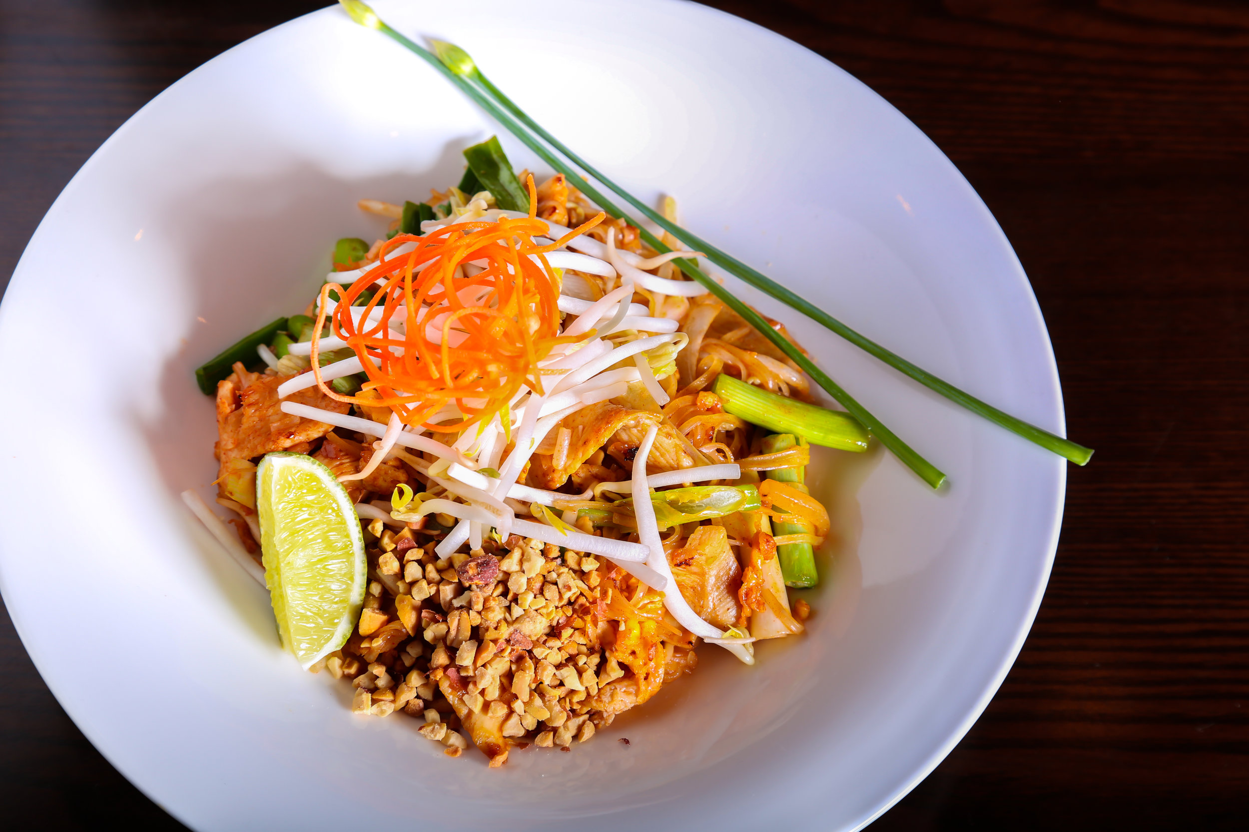 Pad Thai - Stir-fried thin rice noodle, egg, scallion and bean sprout with crushed peanut.