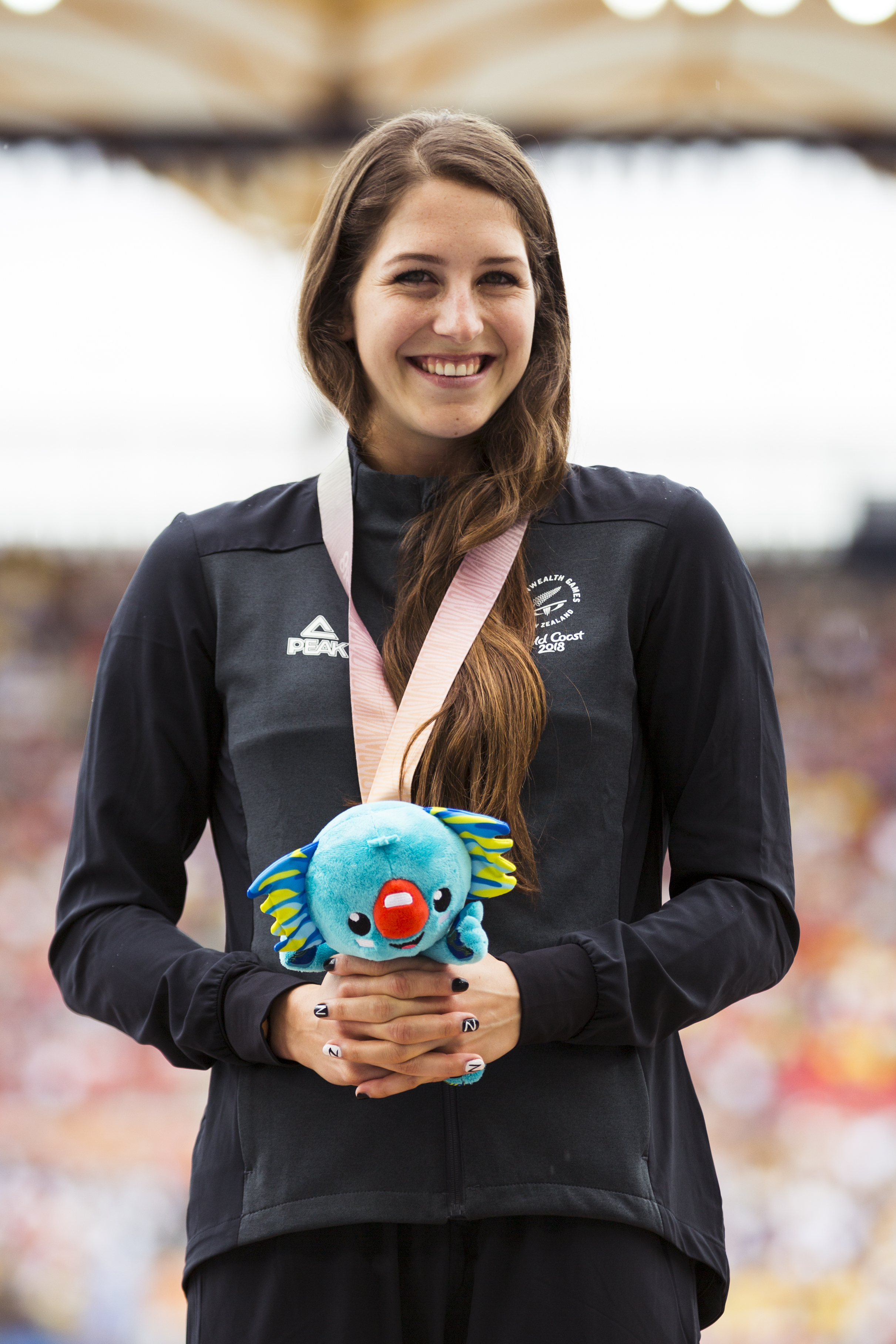 Eliza McCartney presented with her Silver Medal for the Pole Vault with Alysha Newman (gold) and Nina Kennedy (bronze) at the 2018 Commonwealth Games. Gold Coast, Australia. Copyright photo: Alisha Lovrich / www.photosport.nz