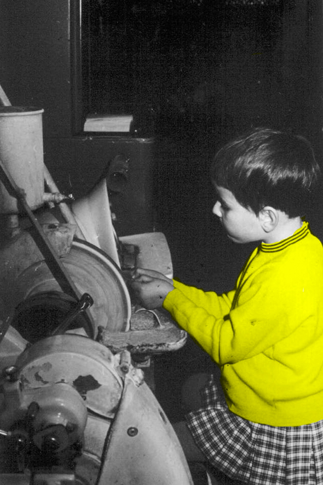 Catherine, Nicolas' mam – 5 y.o. - hand-shaping mineral lenses in the workshop after school, back in 1969. She hasn't really left the workshop since!