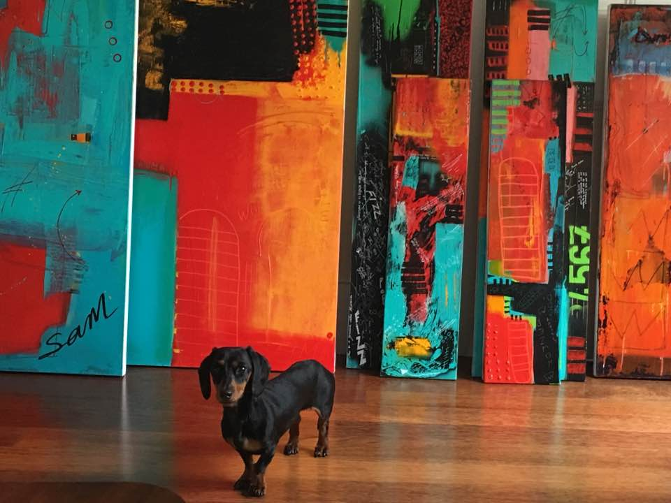 Little Ben now fully recovered in front some of the abstract work that has sold during this past year.