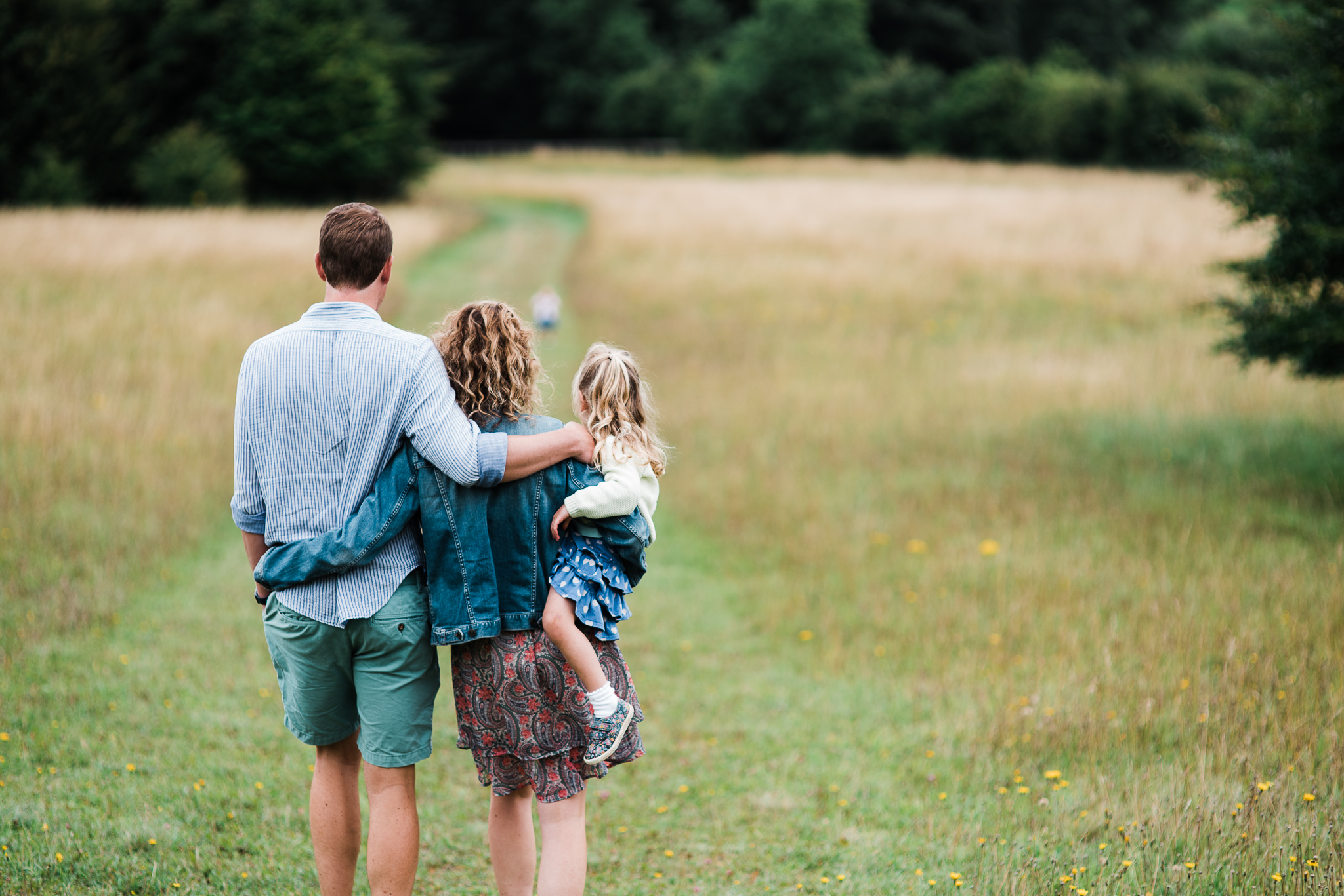 Family walking down hill - Cotswold Family Photo.jpg