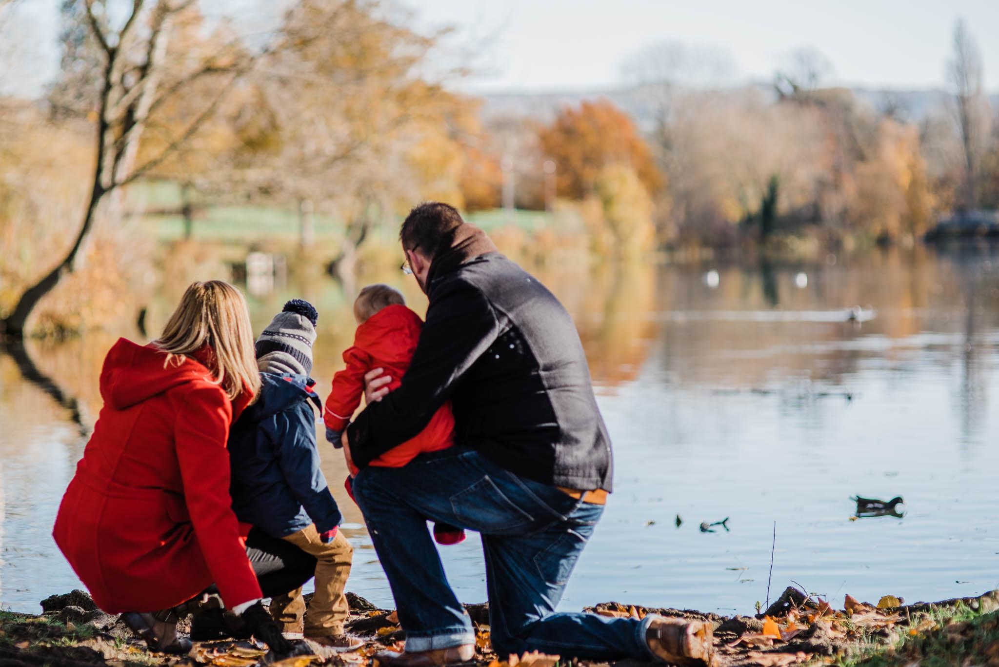Family of four by lake pittville park family photoshoot Cheltenham.jpg