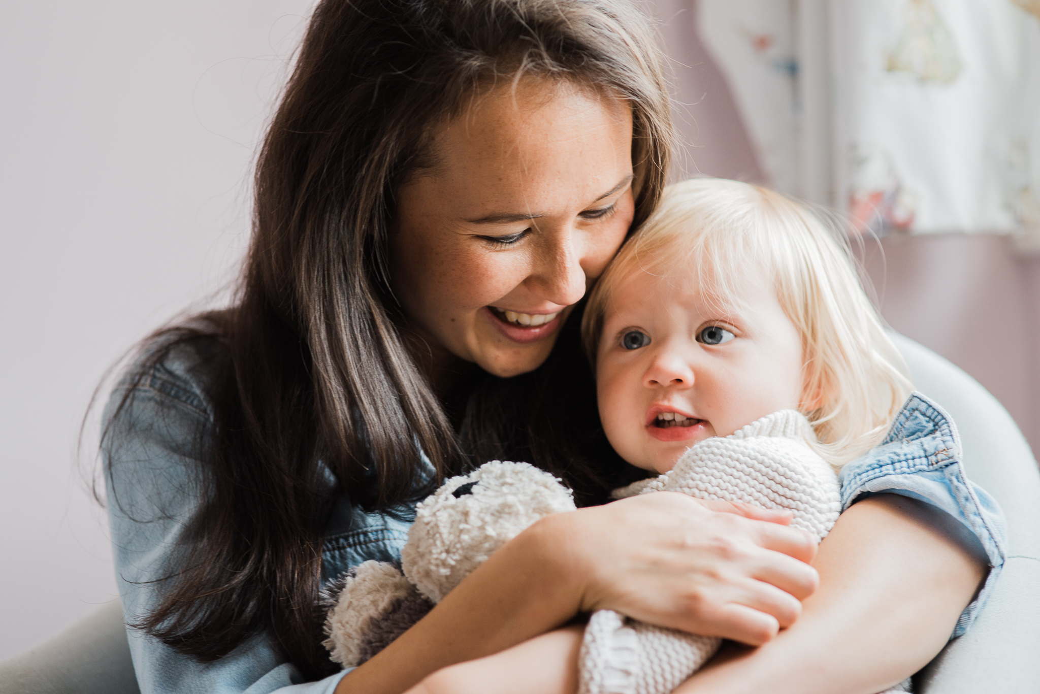 Mother cuddling toddler in home photoshoot Cheltenham.jpg