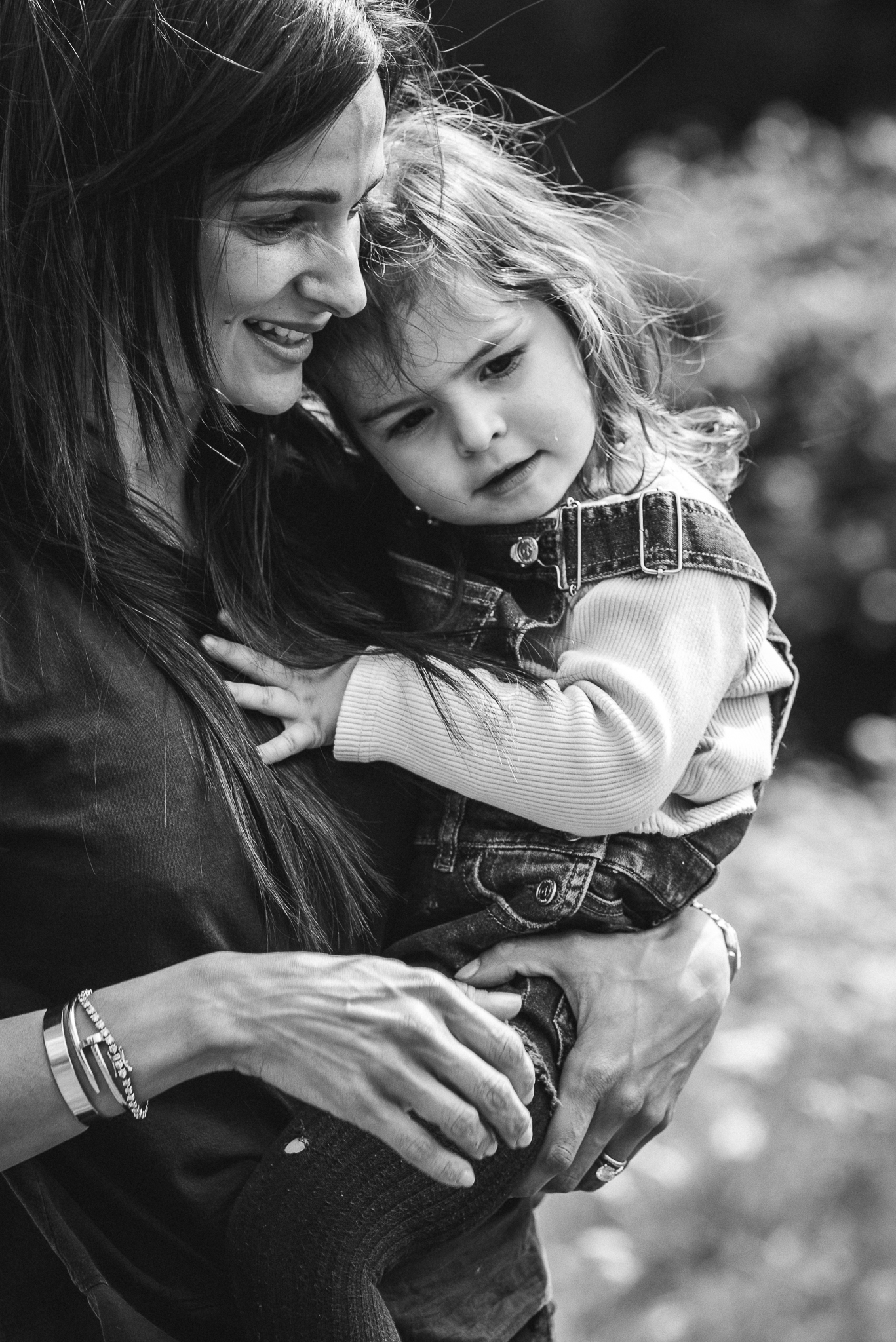 Mother cuddling toddler outdoor photography Cheltenham.jpg