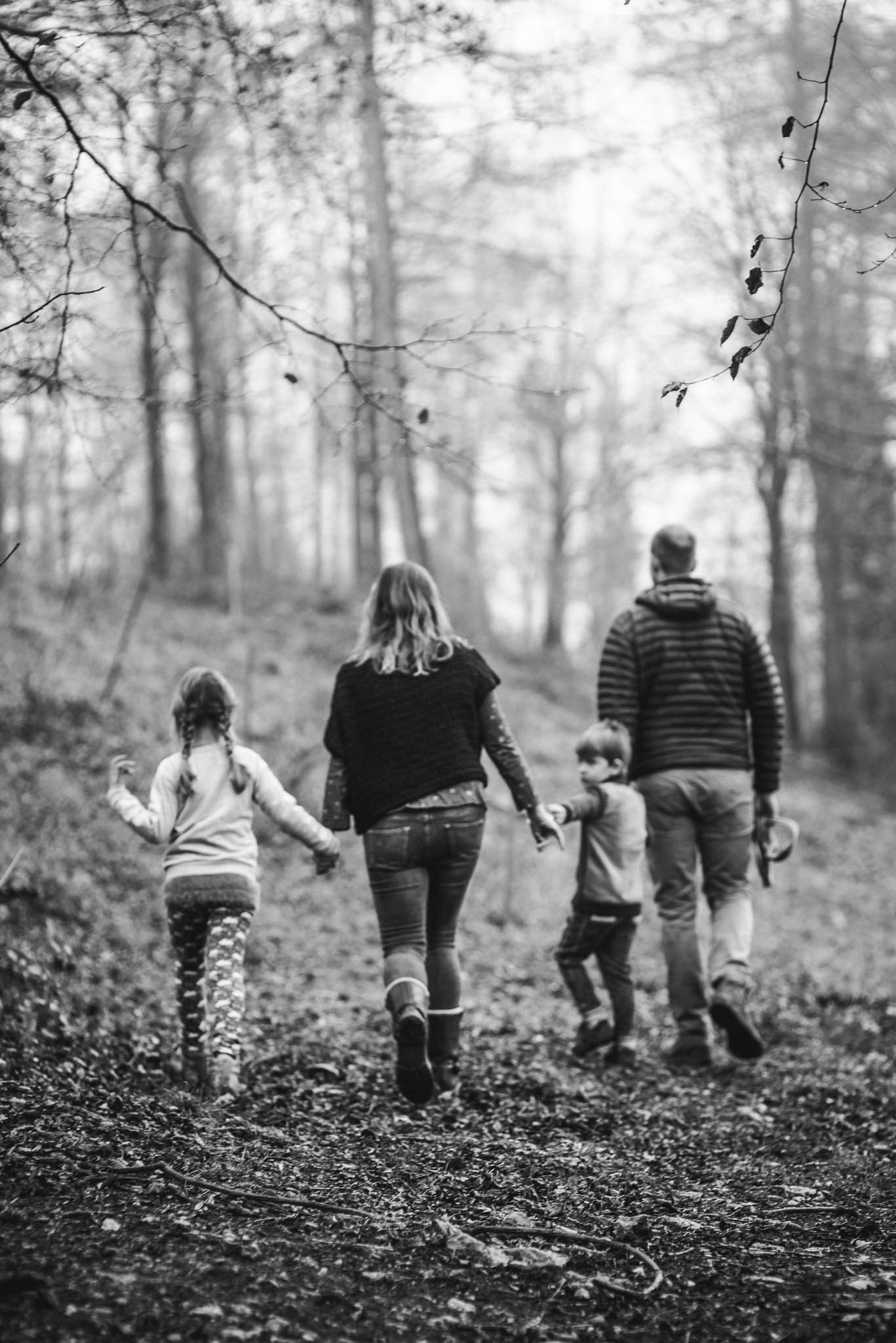 Family exploring woods lifestyle family photographer Cotswolds.jpg