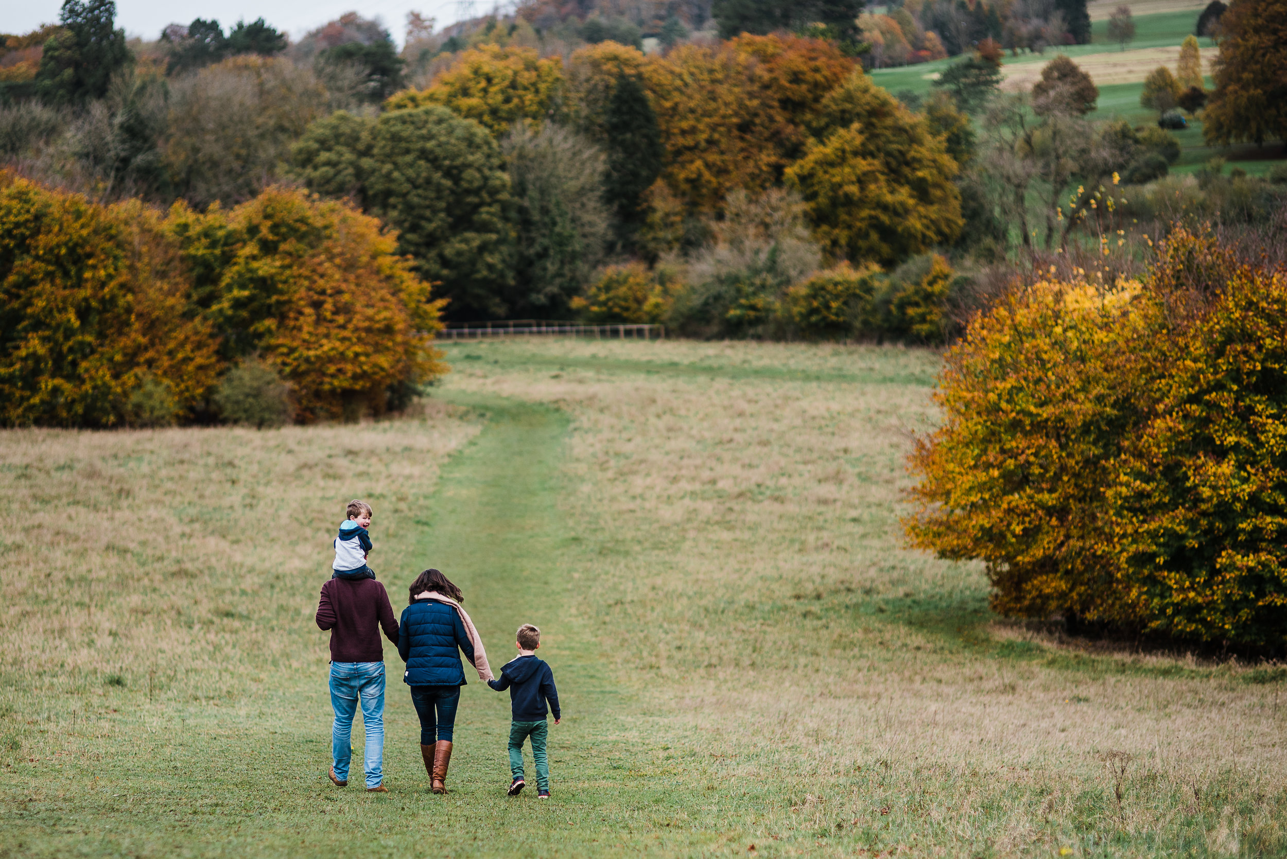 Family walking down hill - Cheltenham Family Photographer.jpg
