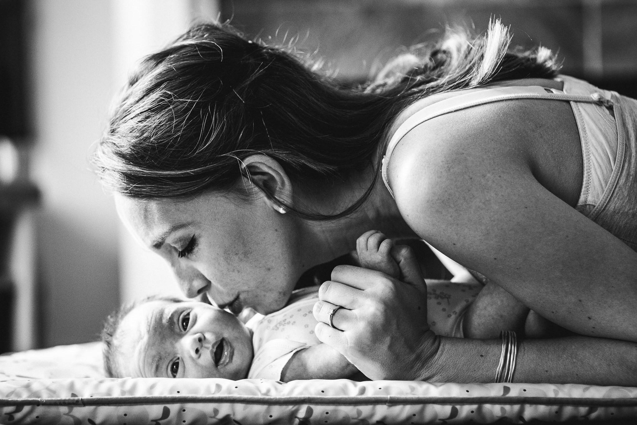 Mother kissing newborn baby Cheltenham Newborn Photorapher.jpg
