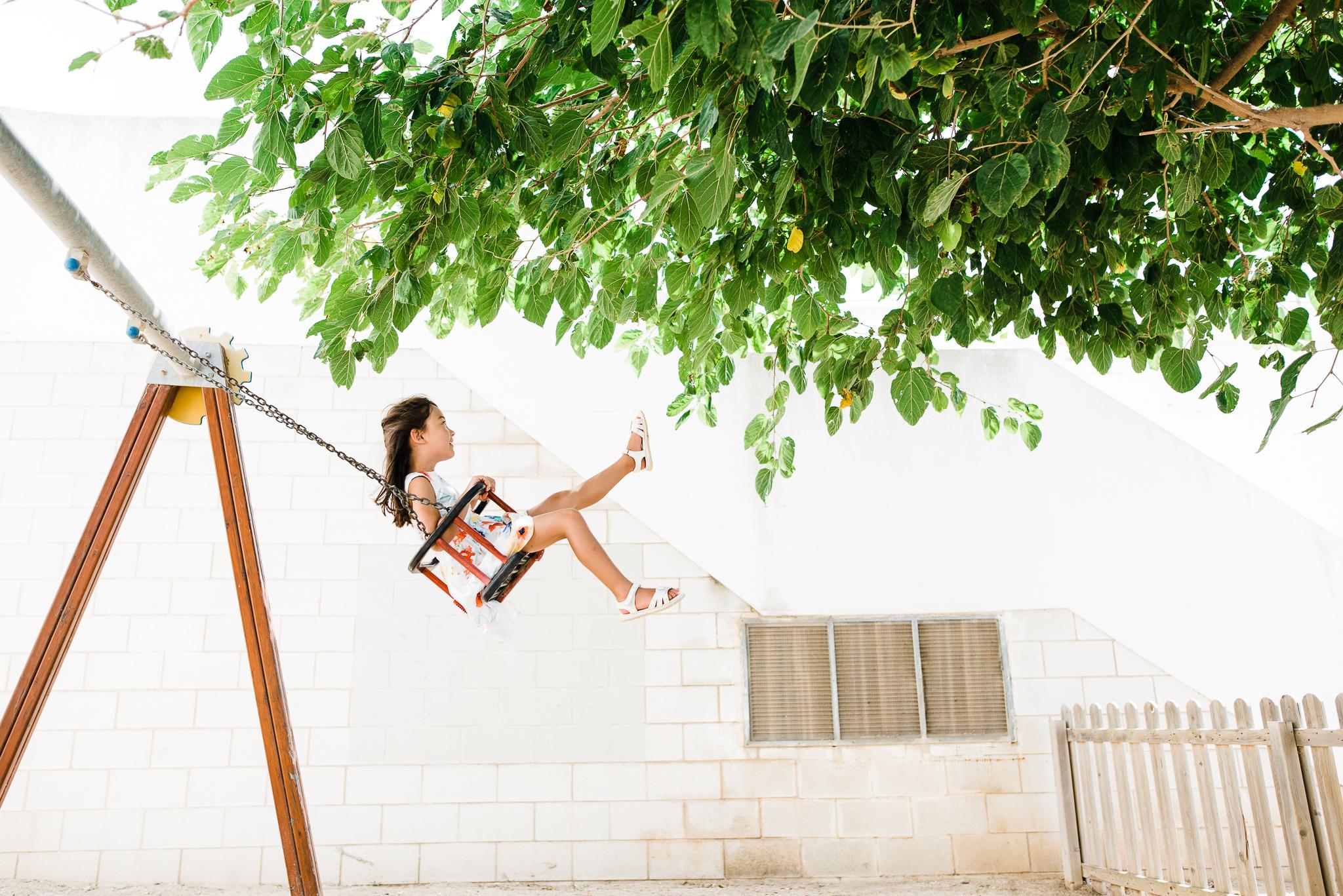 award winning image girl on swings