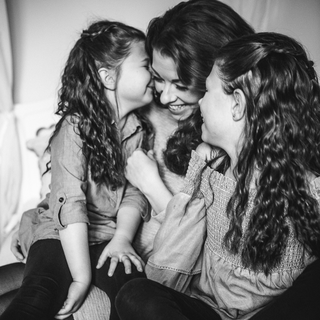 Mother with two girls smiling photo.jpg