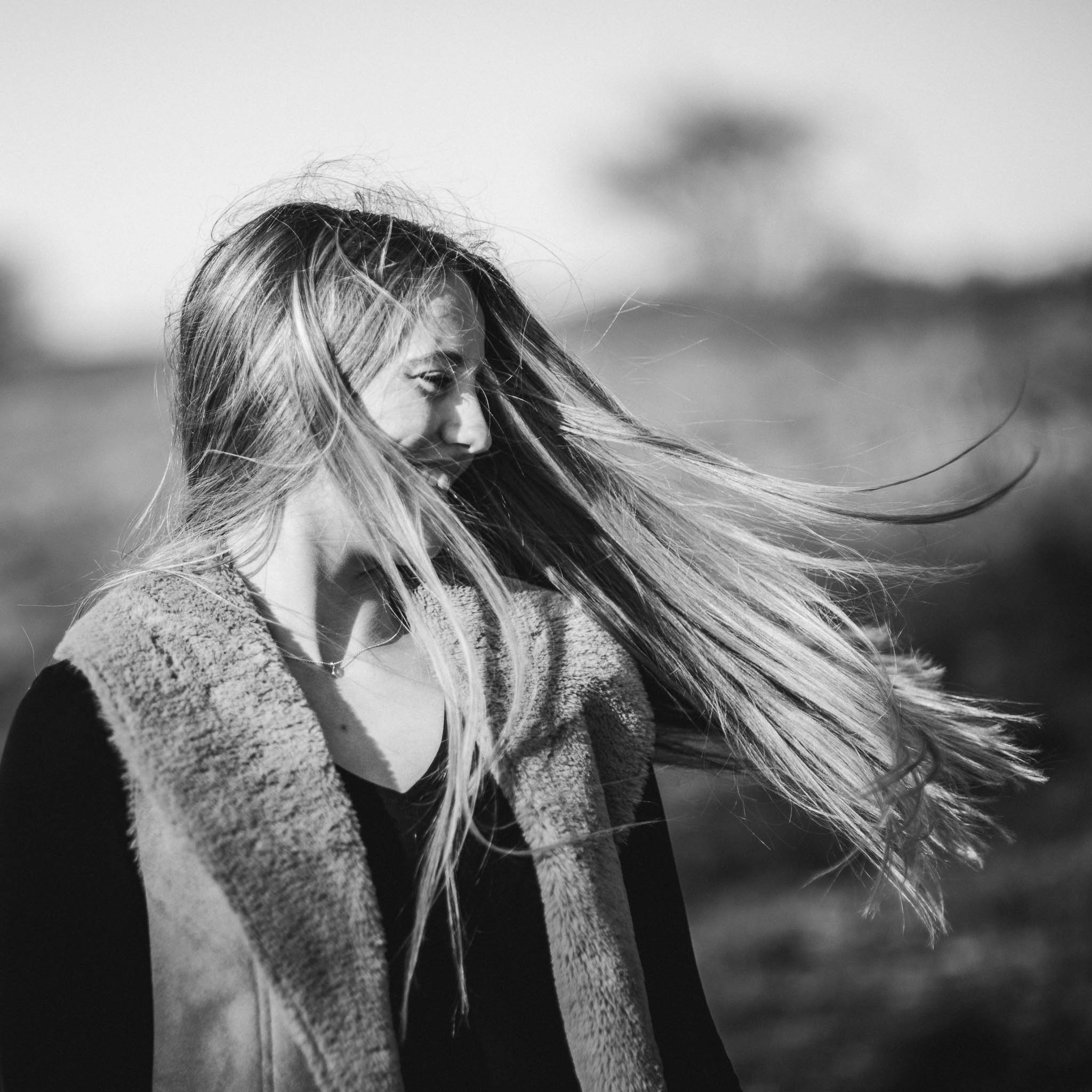Girl with long hair swirling in the wind.jpg