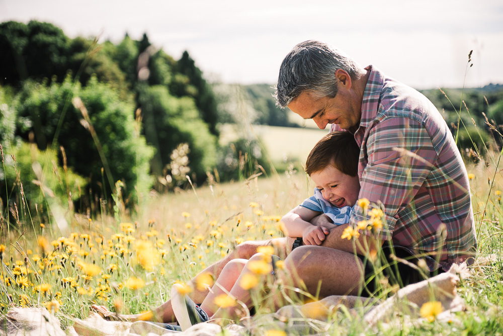 father with son in cotswold field