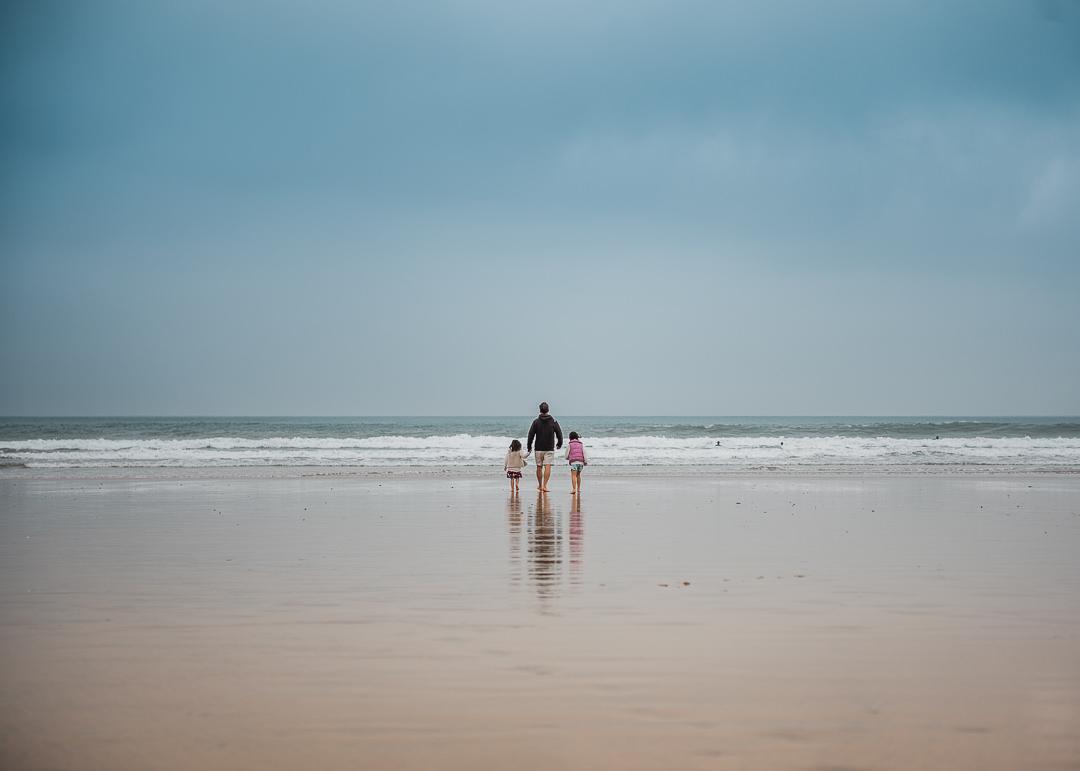 Father with daugheters at beach UK-7348.jpg