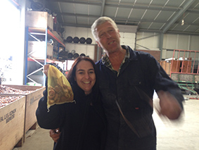 One of our guests holding a bag of authentic Dutch tulip bulbs (alongside the farmer who farmed them)