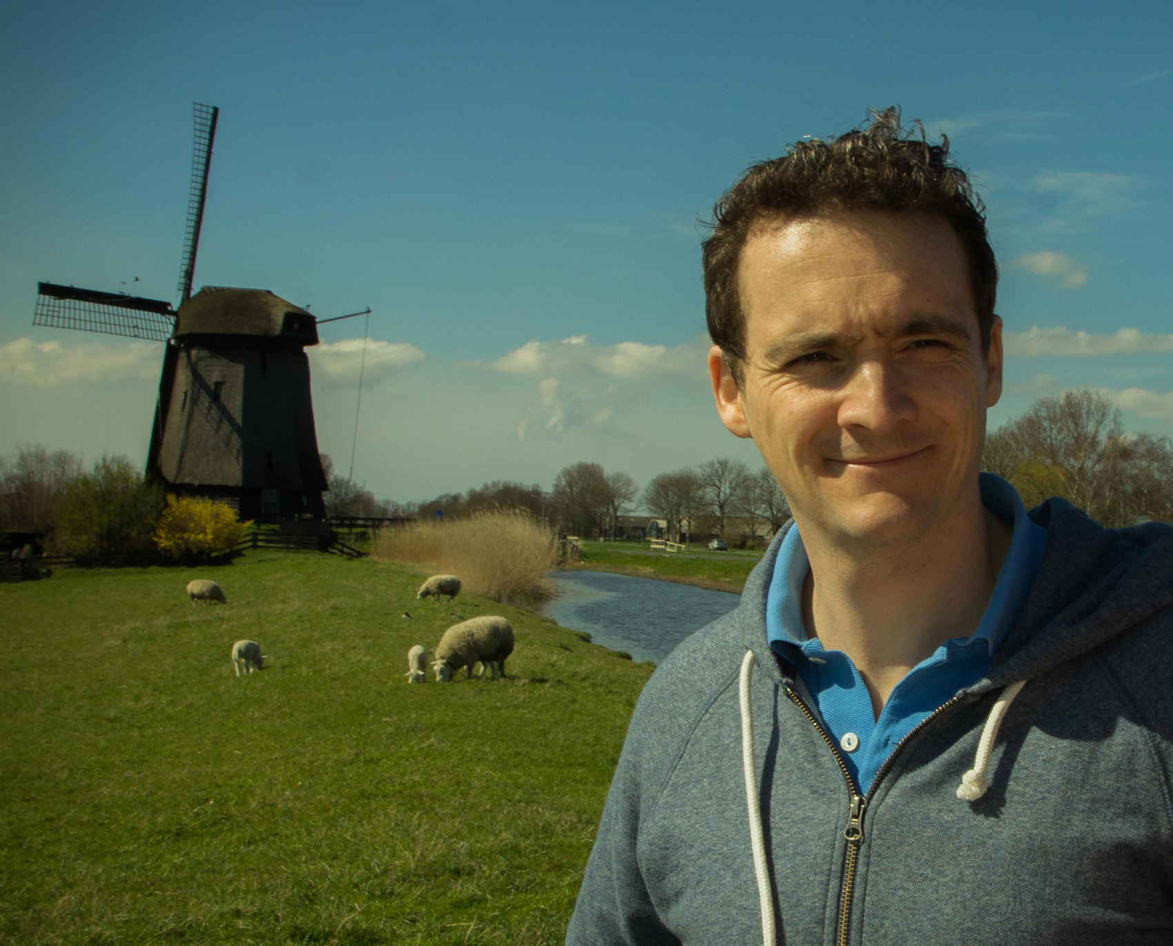 Rory, of Netherlands Culture Tours, at a working windmill from the 1600s.