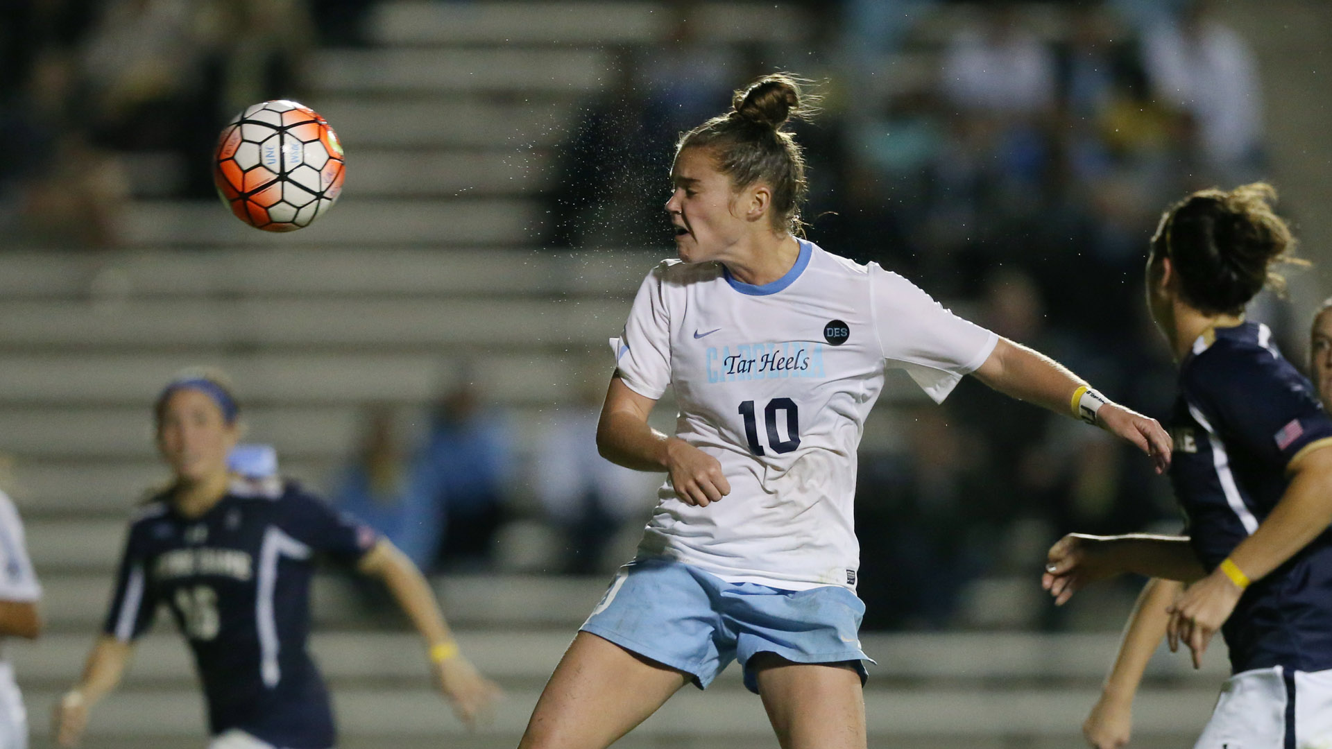 Joanna Boyles (10) heads the ball against Notre Dame, just under three weeks before tearing her ACL in practice.
