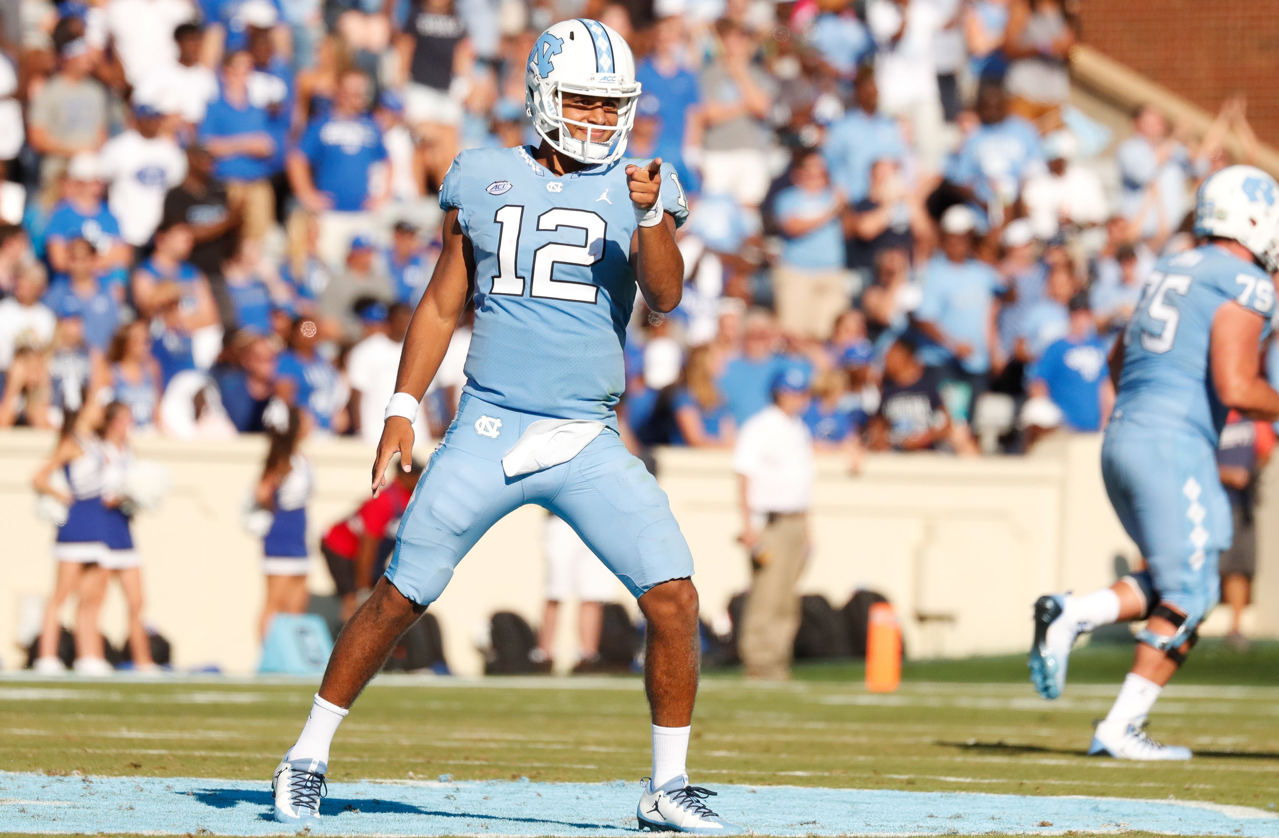 Chazz Surratt (12) set career highs in passing yards (259) and rushing yards (77). But it's the extra plays he tried to make that cost UNC against Duke.