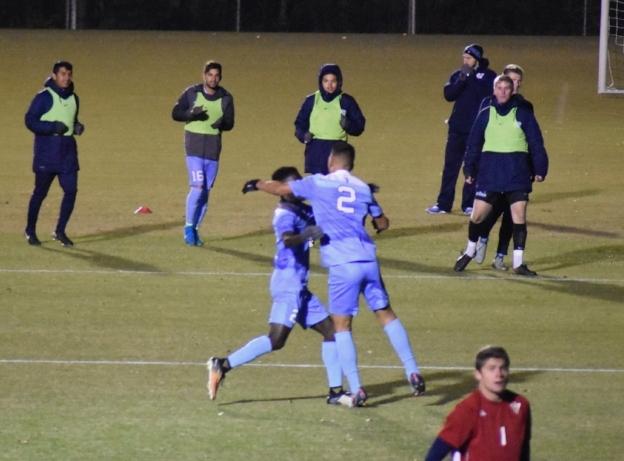 Goal scorers Jelani Pieters (left) and Mauricio Pineda (right) embrace after Mauricio's goal puts Carolina up 2-0
