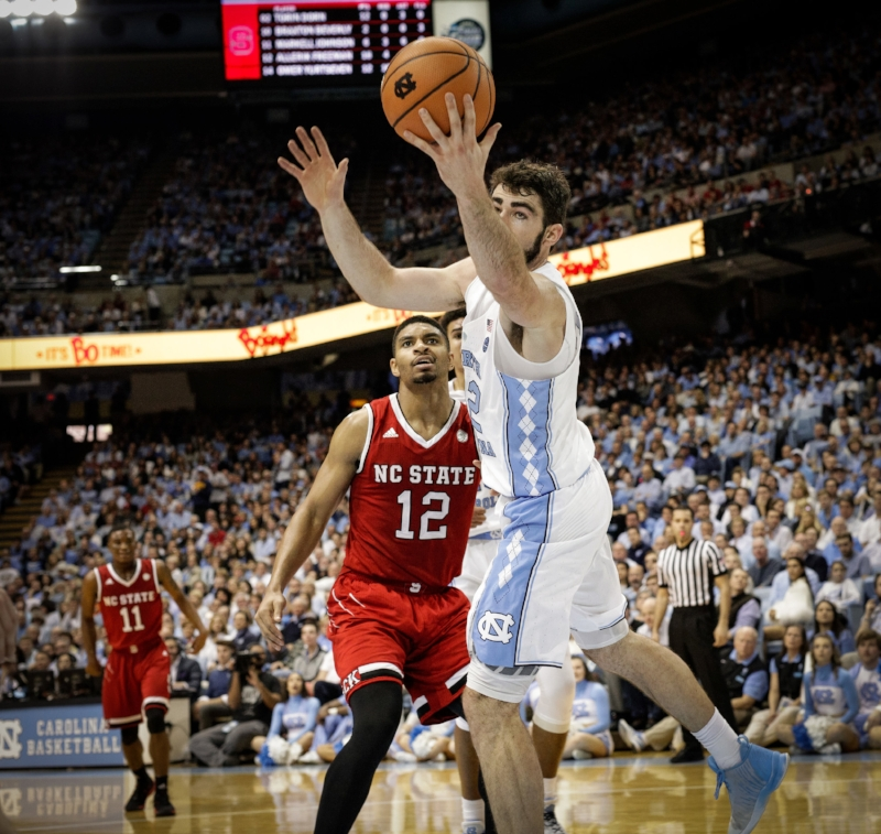 At 6-foot-8, Luke Maye (32) wasn't enough inside to deter N.C. State's big men in Saturday's overtime loss. | Photo by Smith Hardy