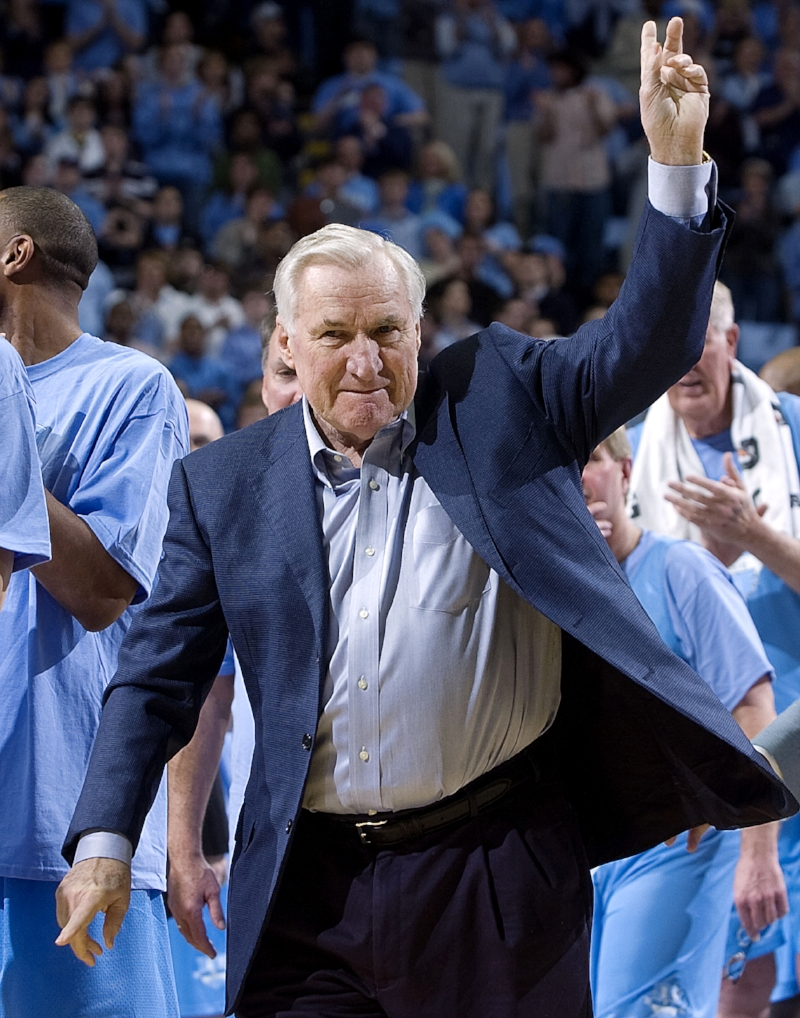 Dean Smith received a roaring applause as he stood on the Smith Center court in 2010. But had he known he'd be in the spotlight, he likely wouldn't have come at all. | Photo courtesy UNC Athletic Communications