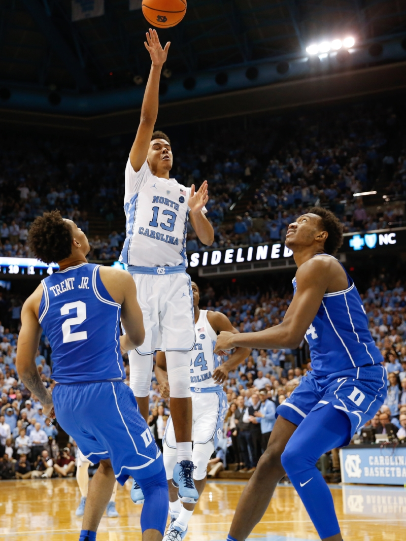 Cameron Johnson (13) combined with Kenny Williams (not pictured) to make all seven of UNC's three-pointers in the first half. | Photo by Alex Kormann
