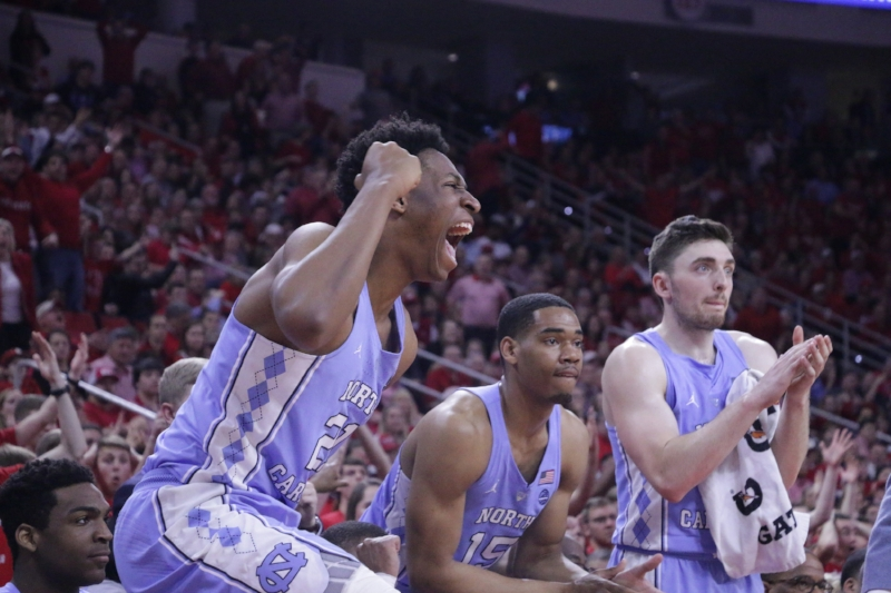 Sterling Manley (21) had five points in eight minutes, but it was his block on Allerik Freeman that brought out his emotion in Saturday's win over N.C. State. | Photo by Gabi Palacio